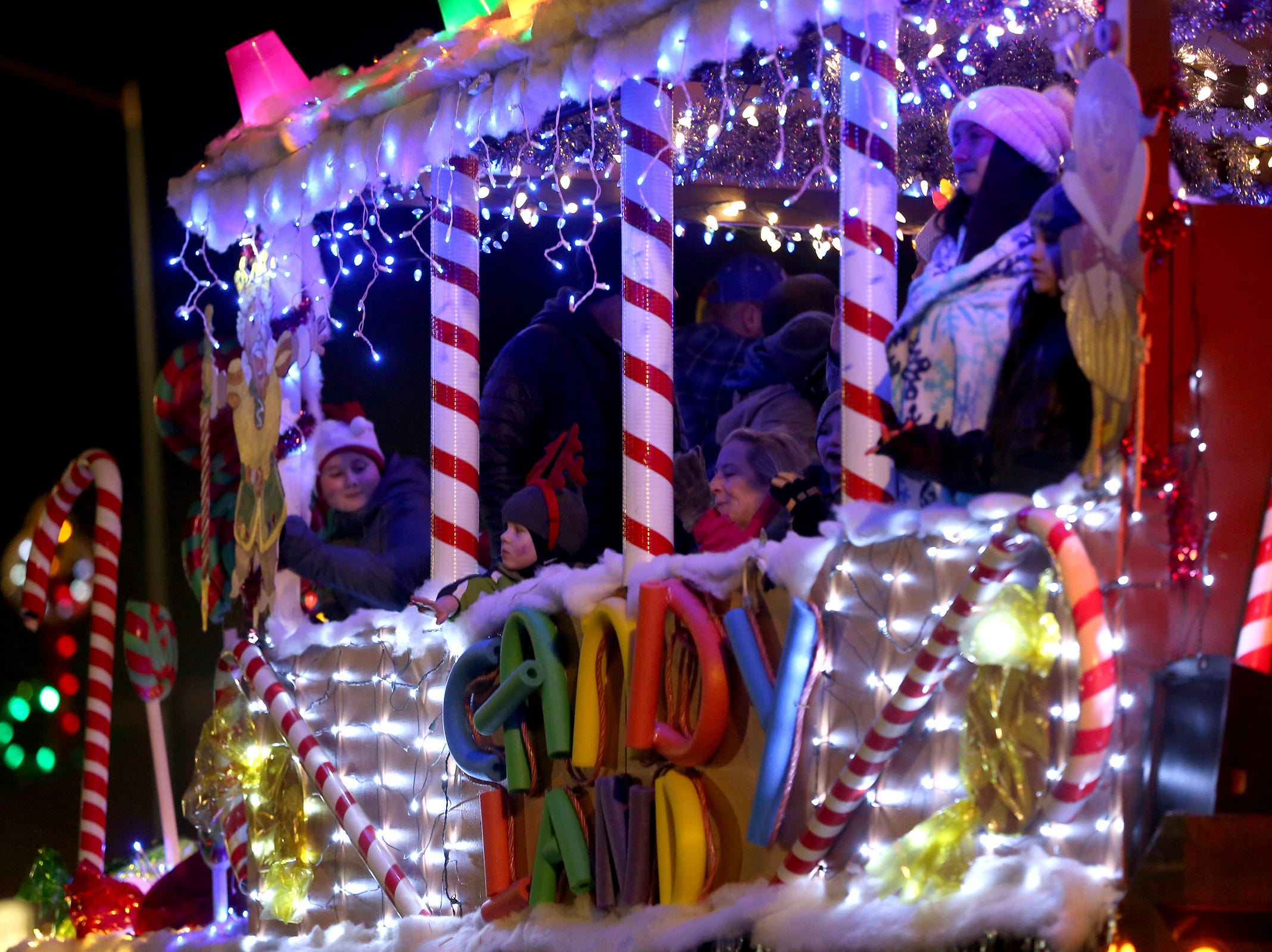 A float representing the Christmas in Candyland theme rides by in the Keizer Holiday Lights Parade in Keizer on Saturday, Dec. 8, 2018.