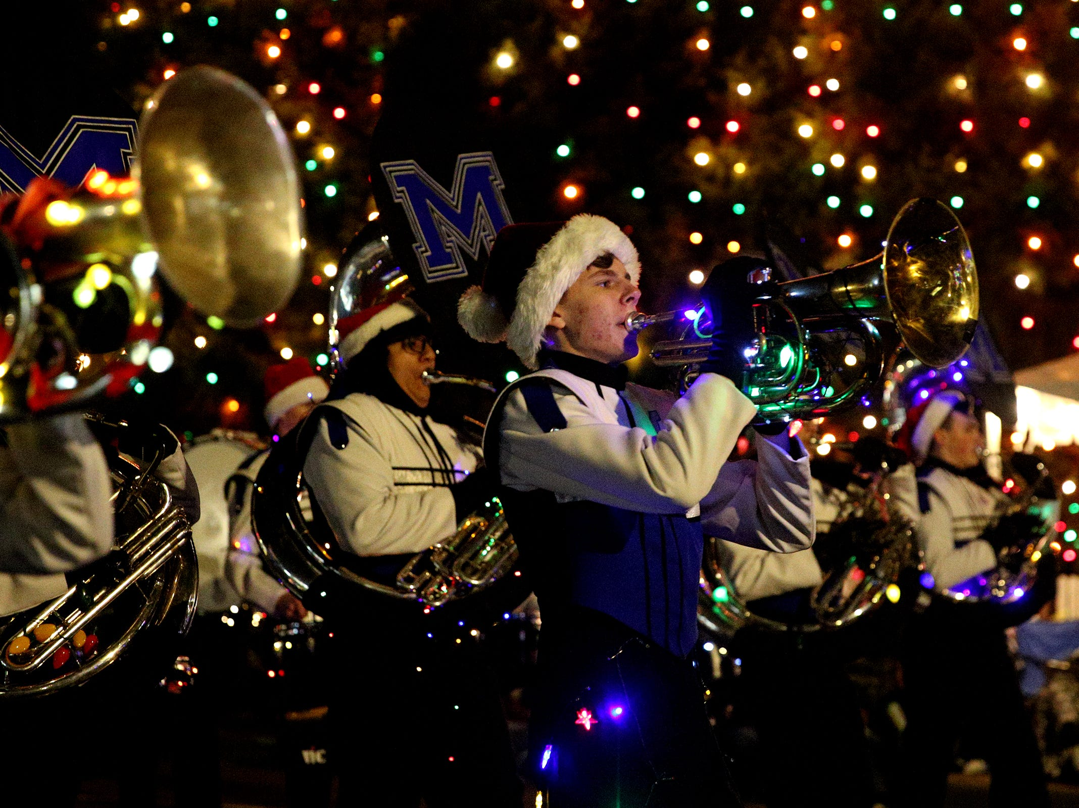 McNary High School's marching band members perform during the Keizer Holiday Lights Parade in Keizer on Saturday, Dec. 8, 2018.