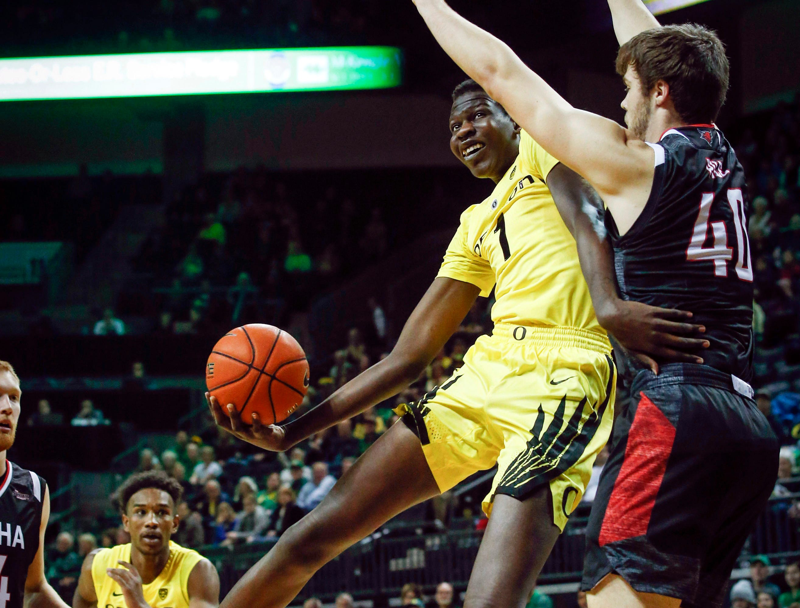 Oregon center Bol Bol (1) drives to the basket against Nebraska-Omaha forward Matt Pile (40) during the first half of their NCAA college basketball game, Saturday, Dec. 8, 2018, in Eugene, Ore.