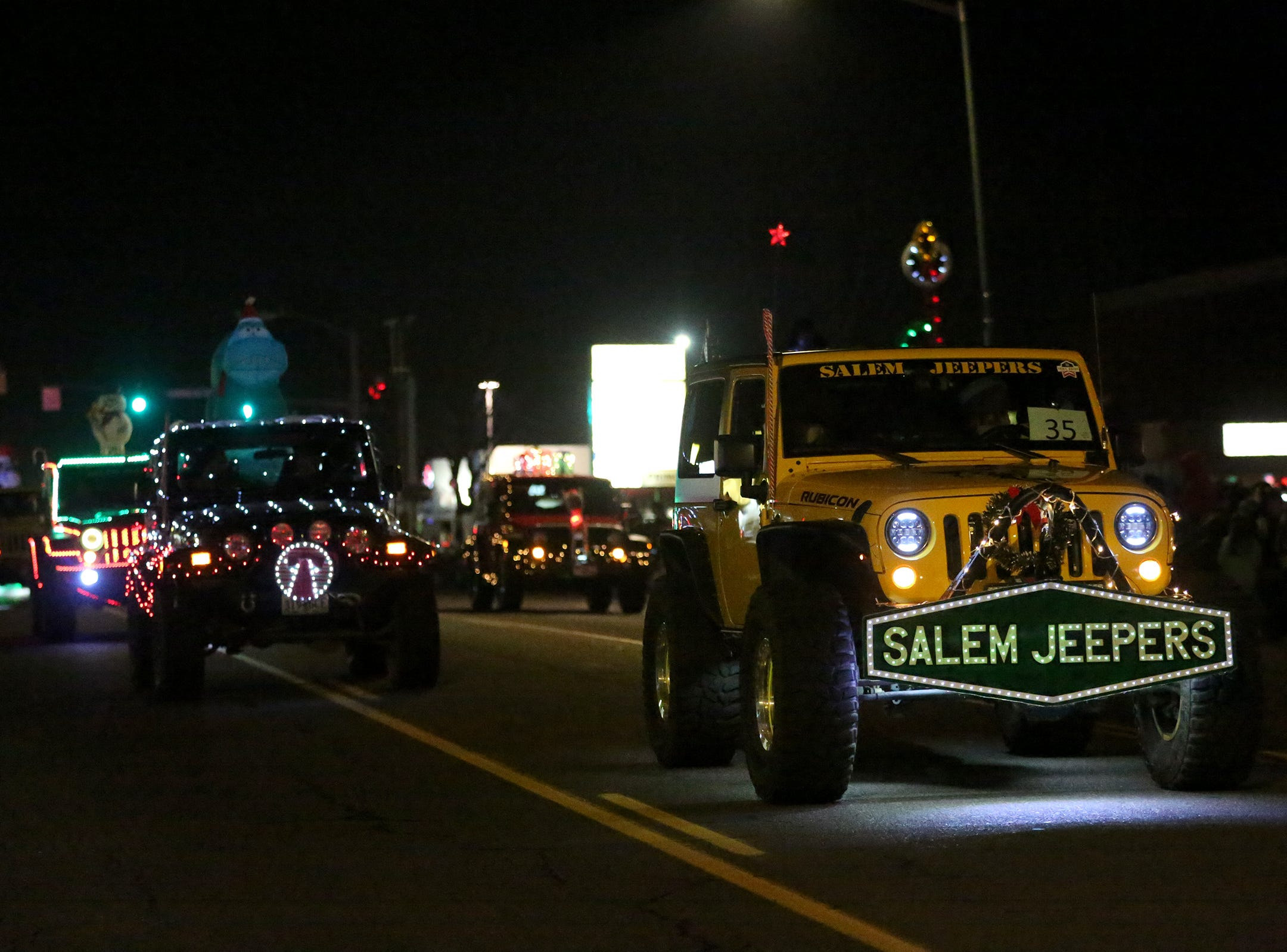 Salem Jeepers ride through the Keizer Holiday Lights Parade in Keizer on Saturday, Dec. 8, 2018.