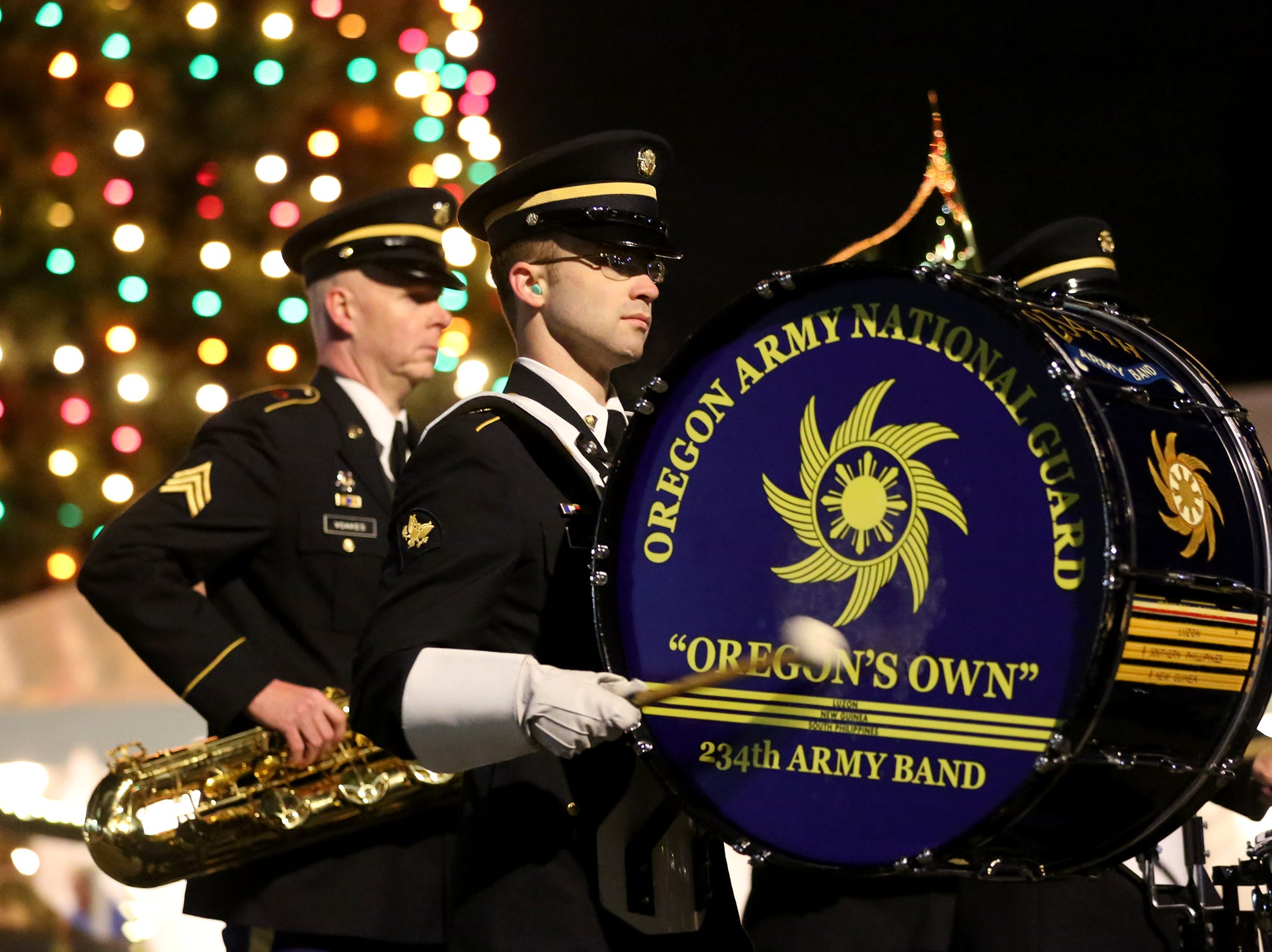 An Oregon Army National Guard drummer marches in the Keizer Holiday Lights Parade in Keizer on Saturday, Dec. 8, 2018.
