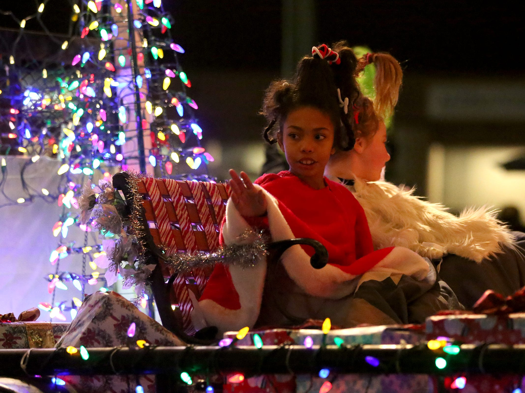 Willow Lake Golf Center & Driving Range showcases their Whovillle themed float during the Keizer Holiday Lights Parade in Keizer on Saturday, Dec. 8, 2018.