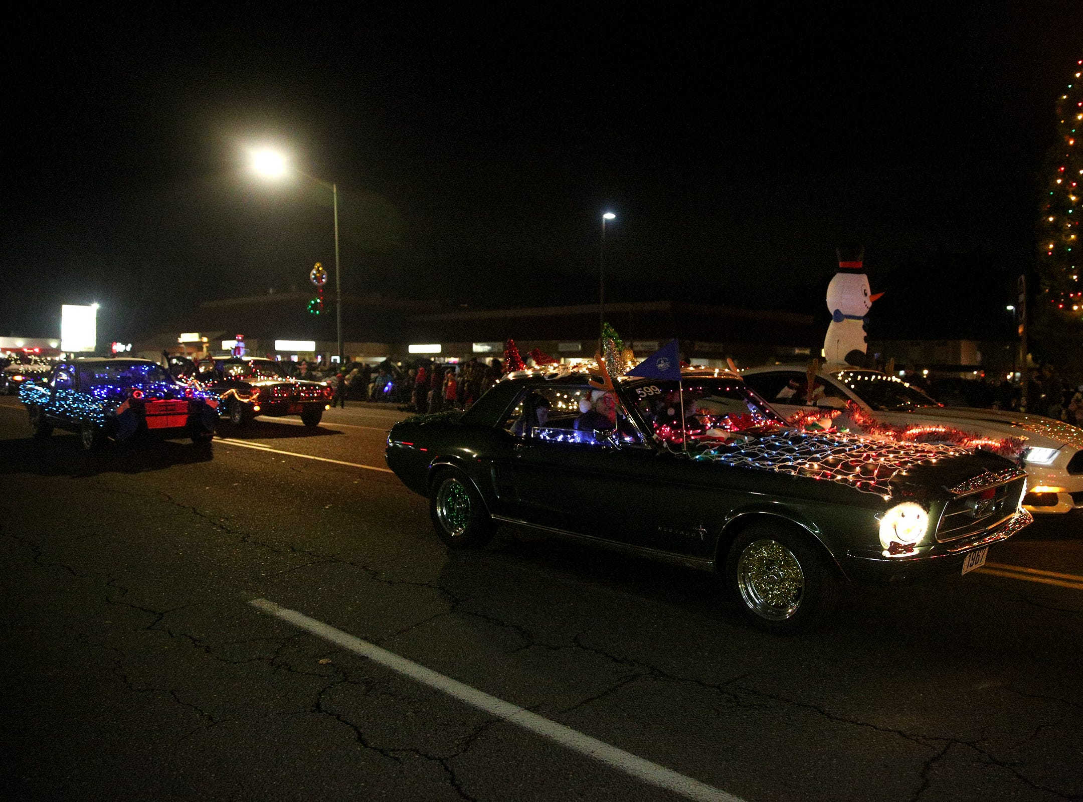 Cars are decorated with lights for the Keizer Holiday Lights Parade in Keizer on Saturday, Dec. 8, 2018.