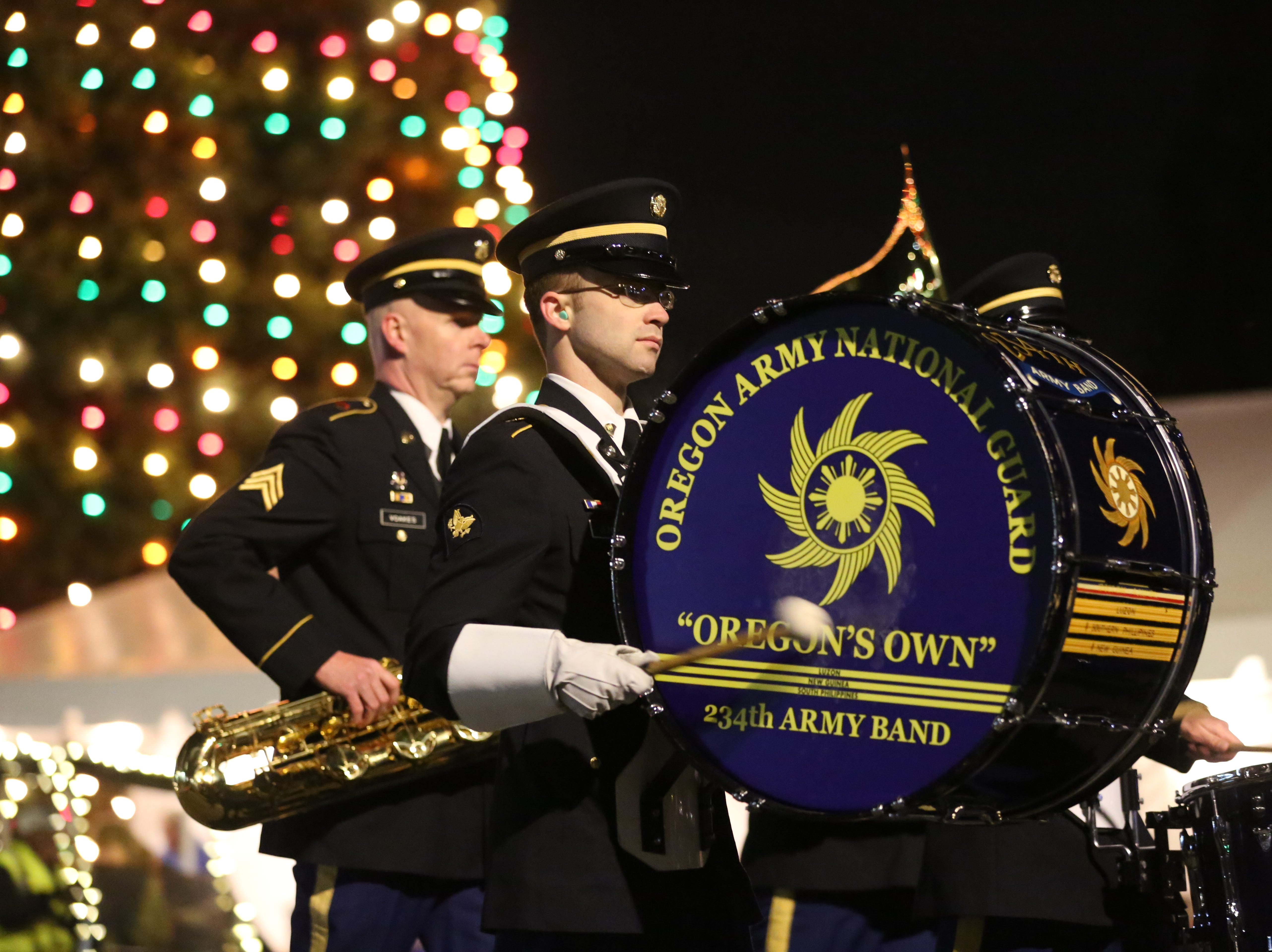 An Oregon Army National Guard drummer plays during the Keizer Holiday Lights Parade in Keizer on Saturday, Dec. 8, 2018.