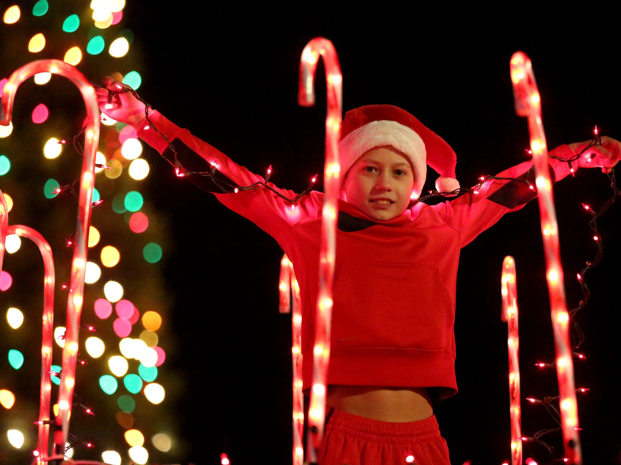 A child smiles from the top of a float during the Keizer Holiday Lights Parade in Keizer on Saturday, Dec. 8, 2018.