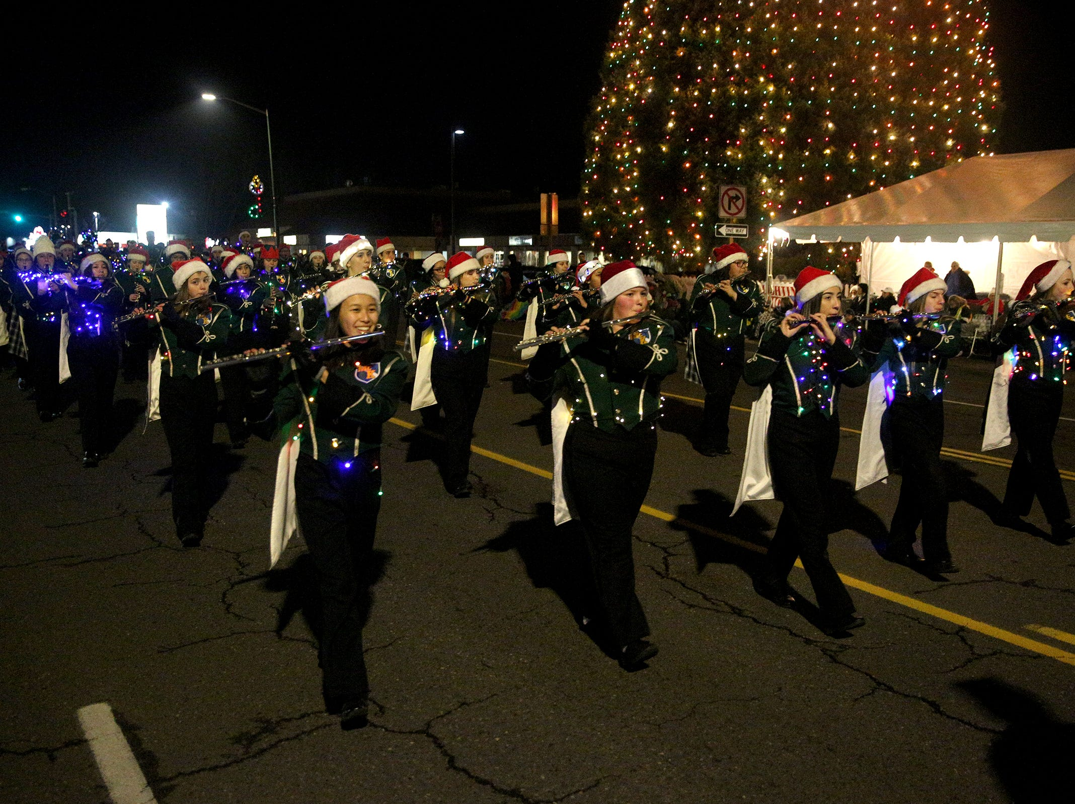 McKay High School's marching band performs during the Keizer Holiday Lights Parade in Keizer on Saturday, Dec. 8, 2018.