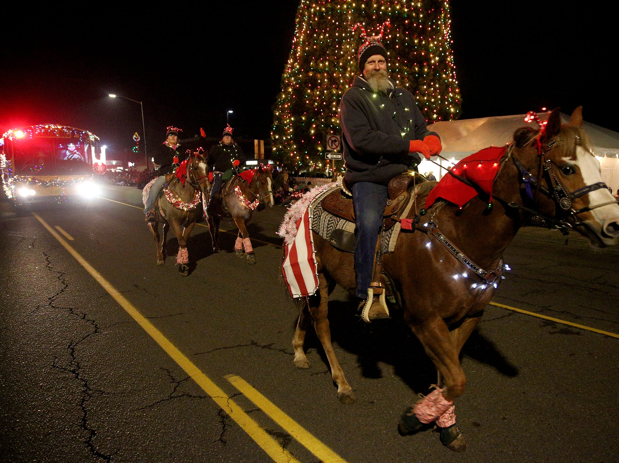 Horses make their way through the Keizer Holiday Lights Parade in Keizer on Saturday, Dec. 8, 2018.