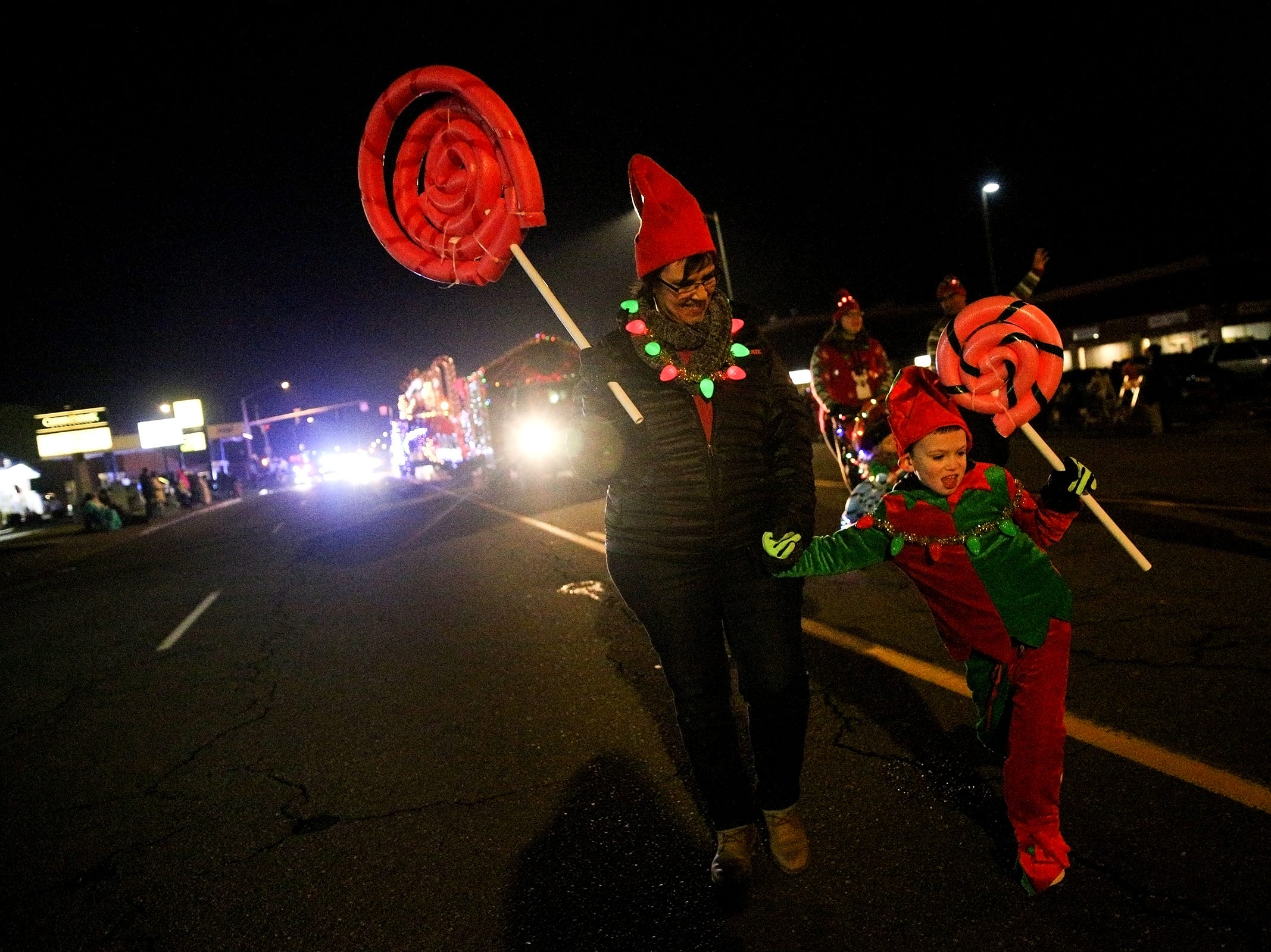Parade marchers follow this years theme, Christmas in Candyland, during the Keizer Holiday Lights Parade in Keizer on Saturday, Dec. 8, 2018.