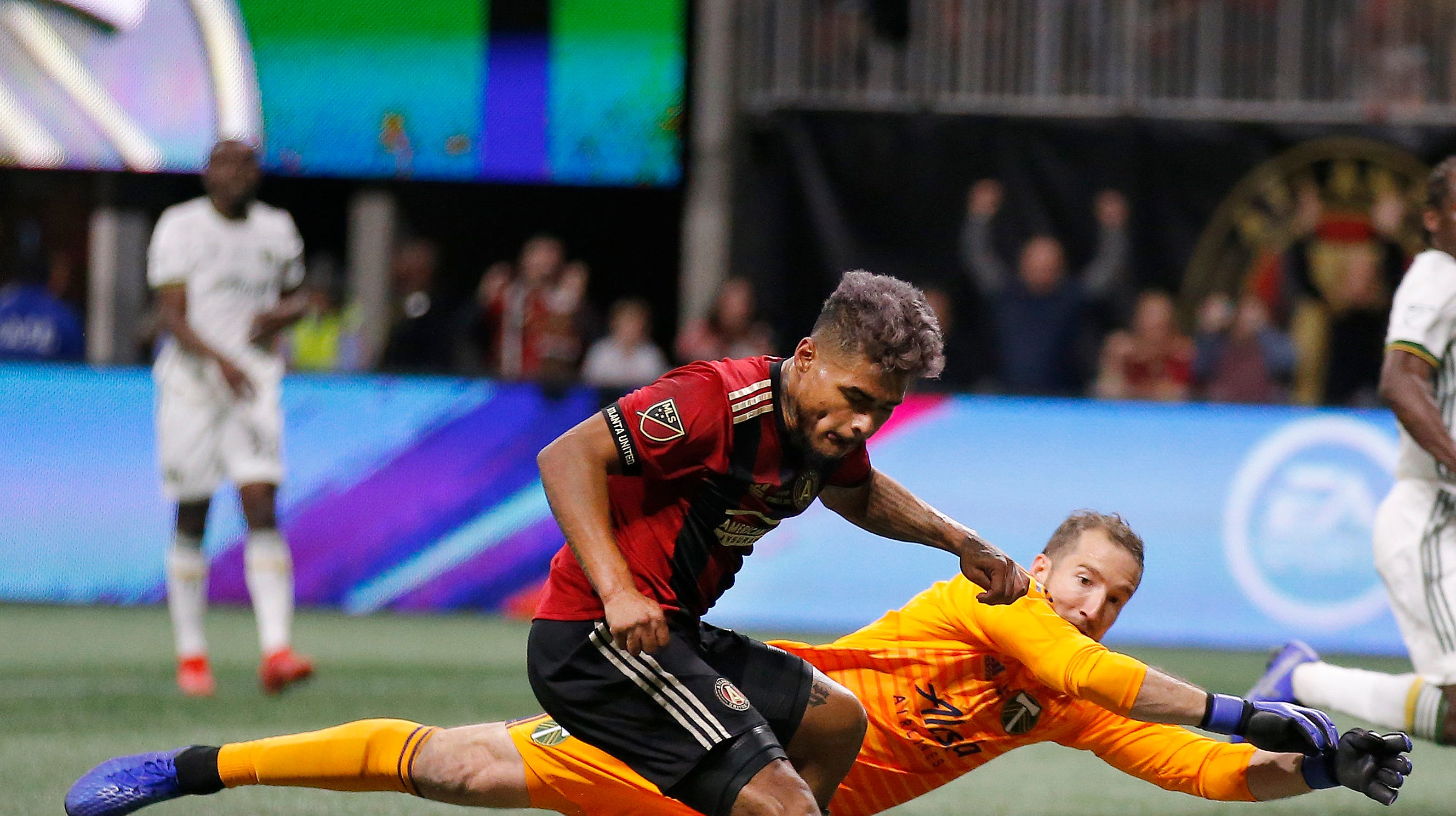 Atlanta United forward Josef Martinez (7) beats Portland Timbers goalkeeper Jeff Attinella (1) to score a goal during the first half of the MLS Cup championship soccer game, Saturday, Dec. 8, 2018, in Atlanta.