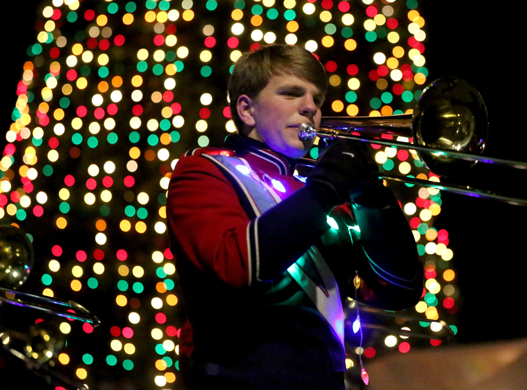 A marching band member from South Salem plays his trombone during the Keizer Holiday Lights Parade in Keizer on Saturday, Dec. 8, 2018.