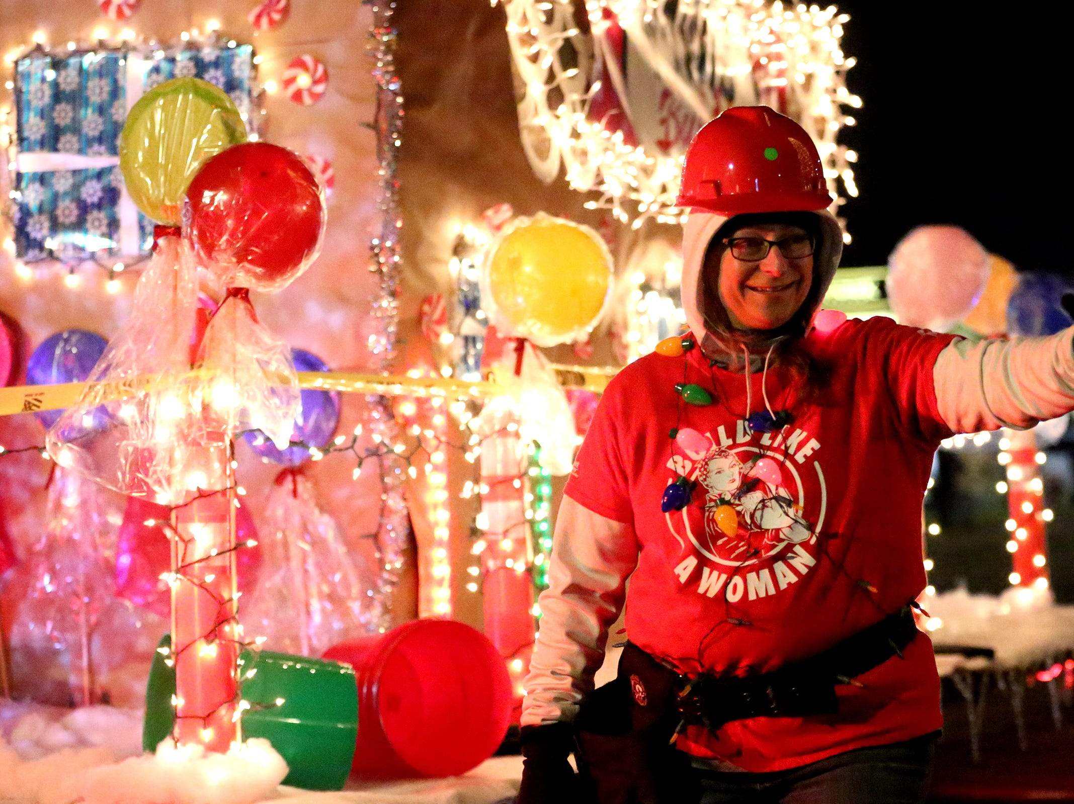 Members of the National Association of Women in Construction showcase their float during the Keizer Holiday Lights Parade in Keizer on Saturday, Dec. 8, 2018.