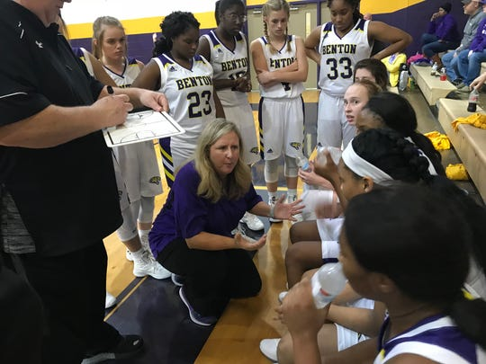 Benton coach Mary Ward pleads her case with her team during the finals of the Lady Tigers' Trak-1 Tournament Saturday night in Benton.