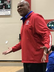 Evangel boys coach Leon Neal coaches during Saturday's Parkway Tournament.