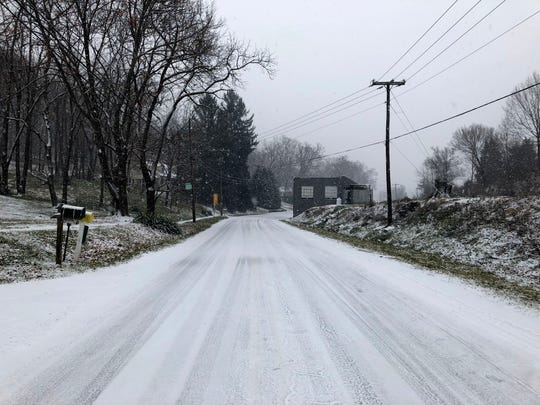 Snow hits the Valley on Sunday, Dec. 9, 2018. The storm is expected to dump between 3 to 5 inches of snow throughout the day for much of the area. Pictured here is a snow covered Englewood Drive.