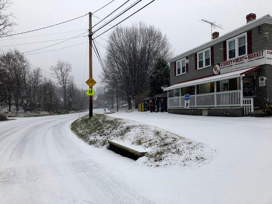 Snow hits the Valley on Sunday, Dec. 9, 2018. The storm is expected to dump between 3 to 5 inches of snow throughout the day for much of the area. Pictured here is Stanley Meat Market on Englewood Drive in Staunton.