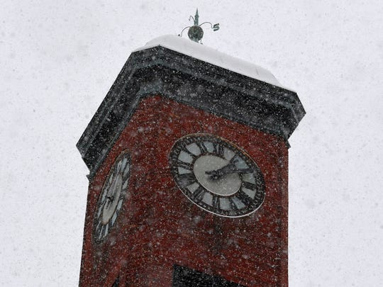 The Staunton Clocktower viewed through the falling snow in downtown Staunton on Sunday, Dec. 9, 2018.