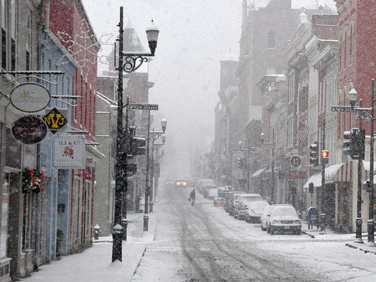 A view looking down Beverley Street as snow falls in downtown Staunton on Sunday, Dec. 9, 2018.