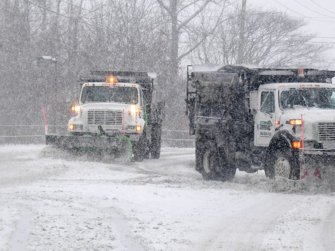 A pair of snowplows work in tandem while clearing snow from Greenville Avenue in Staunton on Sunday, Dec. 9, 2018.