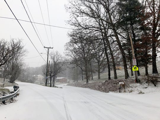 Snow hits the Valley on Sunday, Dec. 9, 2018. The storm is expected to dump between 3 to 5 inches of snow throughout the day for much of the area.  Pictured here is the intersection of Shutterlee Mill Road and Englewood Drive in Staunton.