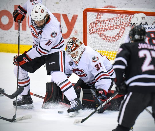 St. Cloud State goalie David Hrenak blocks a shot on goal by Nebraska-Omaha during the first period Saturday, Dec. 8, at the Herb Brooks National Hockey Center.