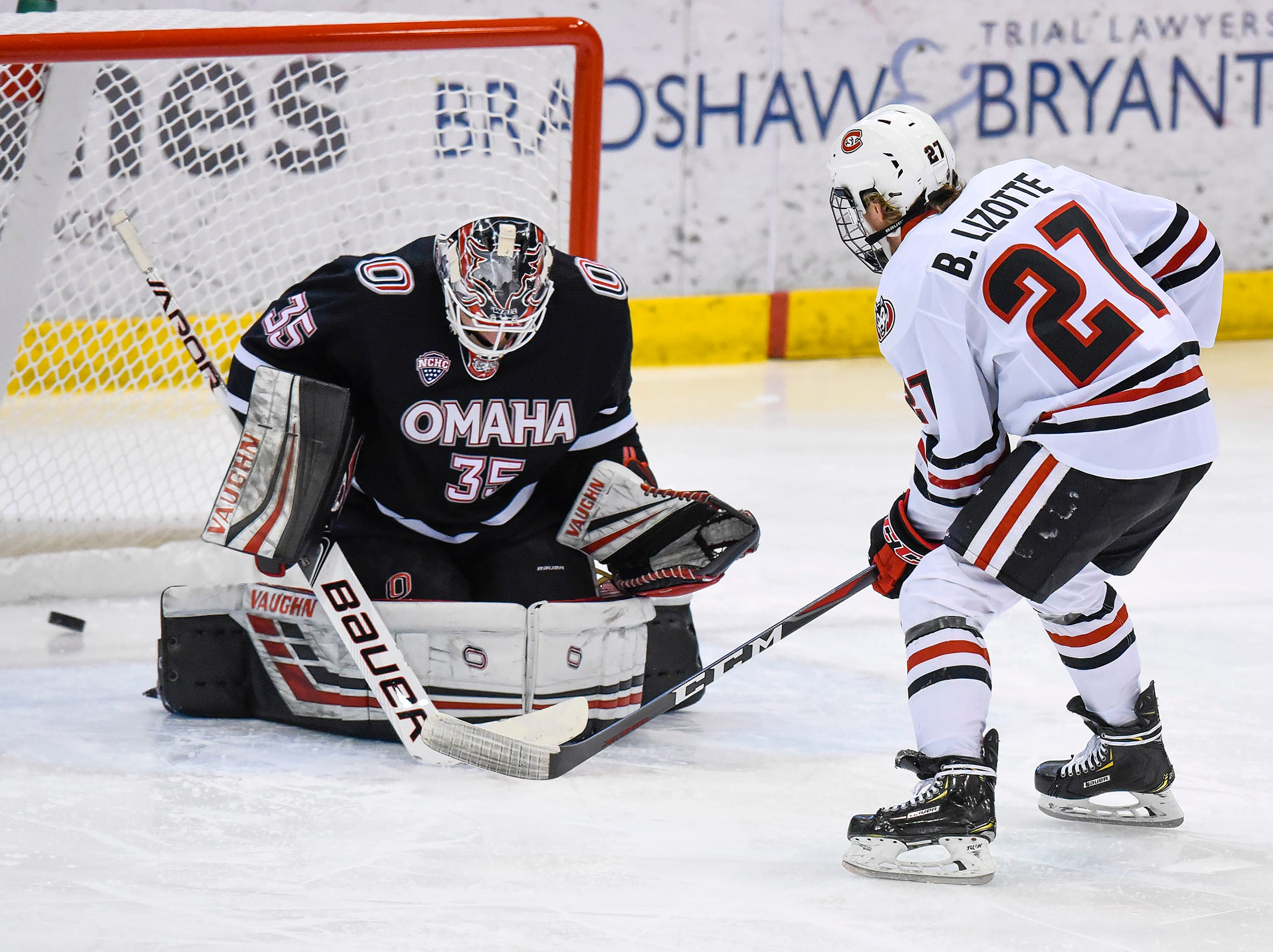 St. Cloud State's Blake Lizotte scores the first goal on Nebraska-Omaha goalie Evan Weninger during the first period Saturday, Dec. 8, at the Herb Brooks National Hockey Center.