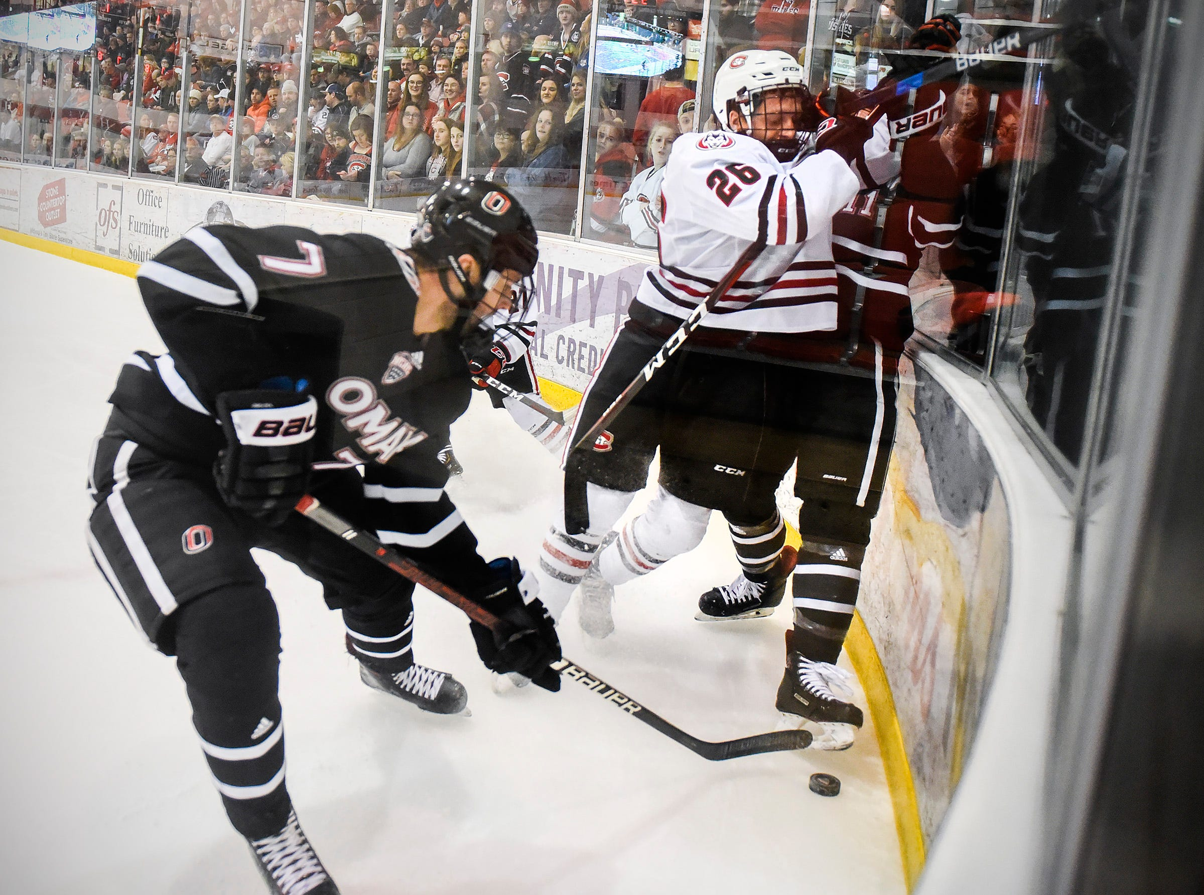 St. Cloud State's Easton Brodzinski battles Nebraska-Omaha's Nate Knoepke, left, and Mason Morelli against the boards for the puck during the first period Saturday, Dec. 8, at the Herb Brooks National Hockey Center.