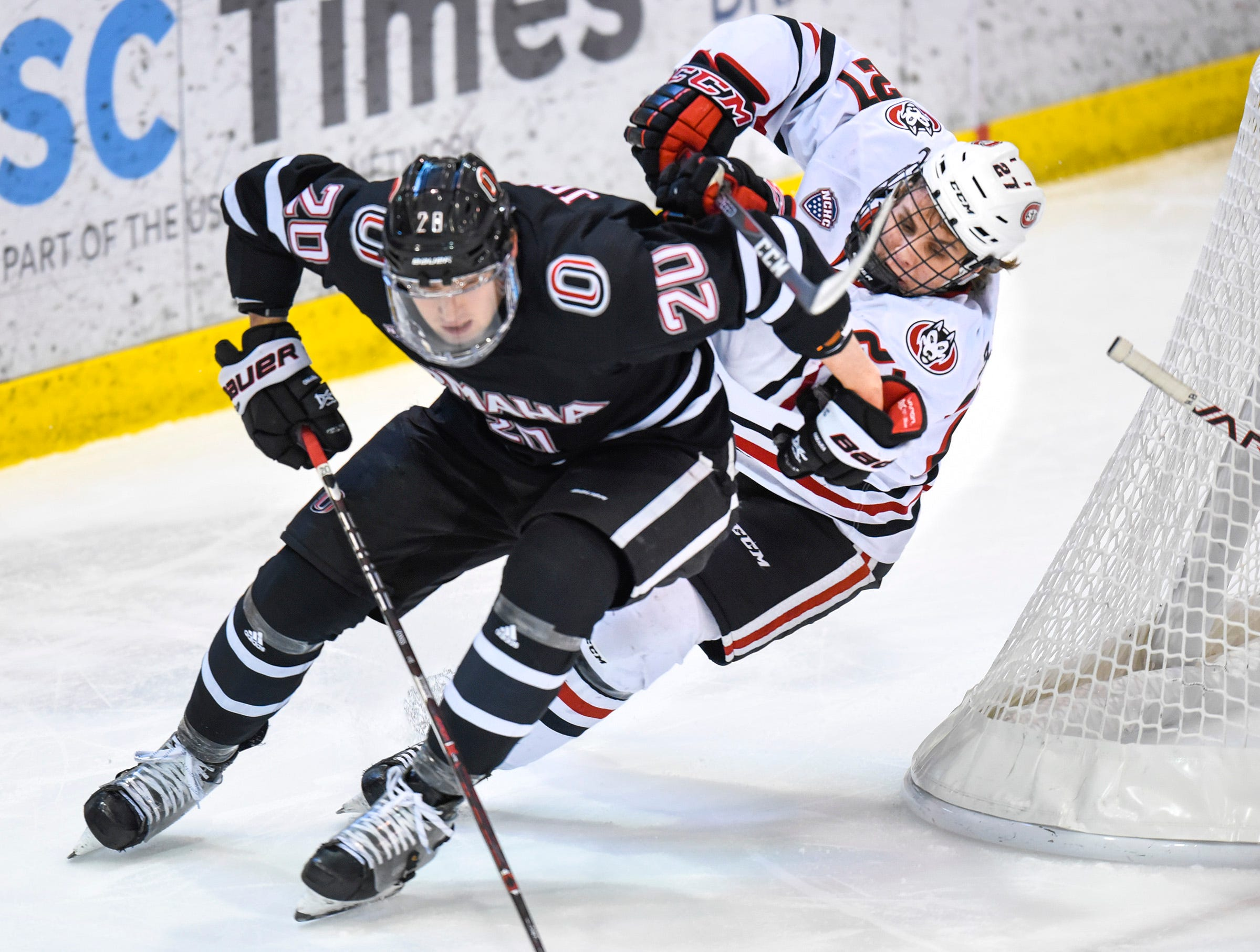 St. Cloud State's Blake Lizotte tries to get the puck from Nebraska-Omaha's Ryan Jones during the first period Saturday, Dec. 8, at the Herb Brooks National Hockey Center.
