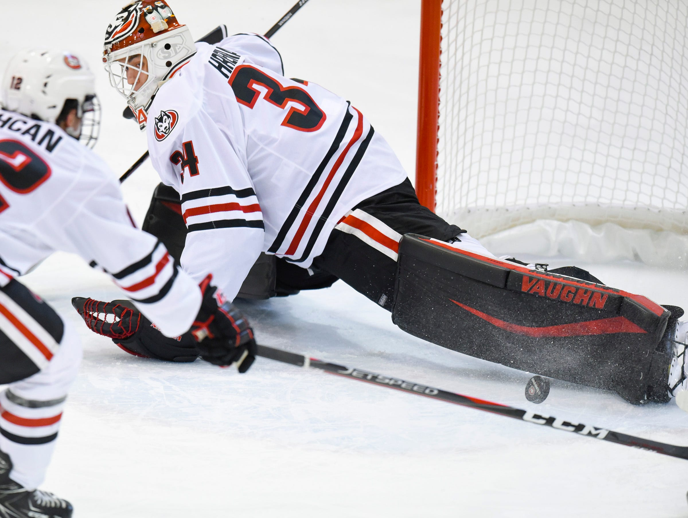 St. Cloud State goalie David Hrenak stops the puck with his pad against Nebraska-Omaha during the first period Saturday, Dec. 8, at the Herb Brooks National Hockey Center.