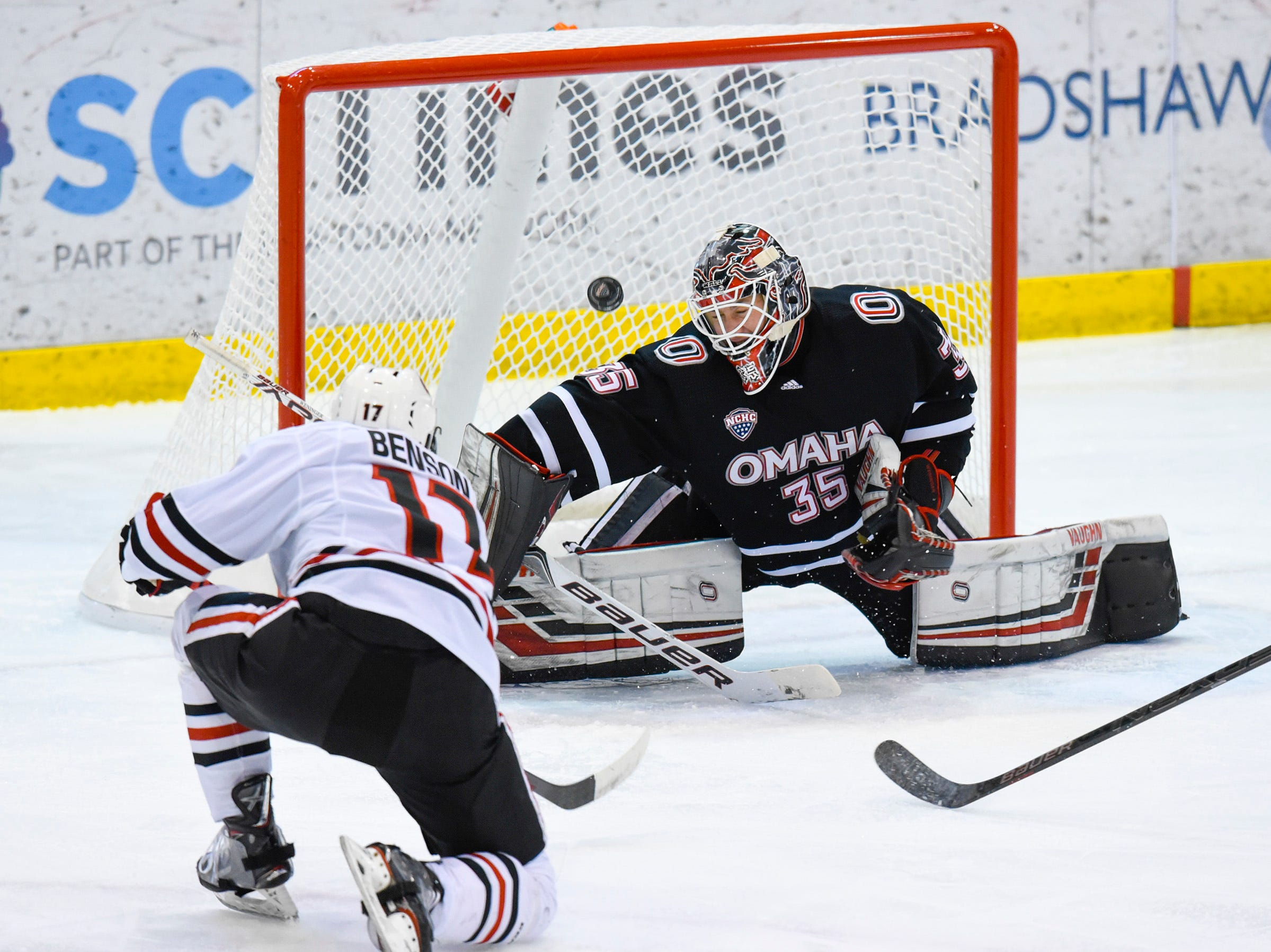 Nebraska-Omaha goalie Evan Weninger blocks a shot by St. Cloud State's Jacob Benson during the first period Saturday, Dec. 8, at the Herb Brooks National Hockey Center.