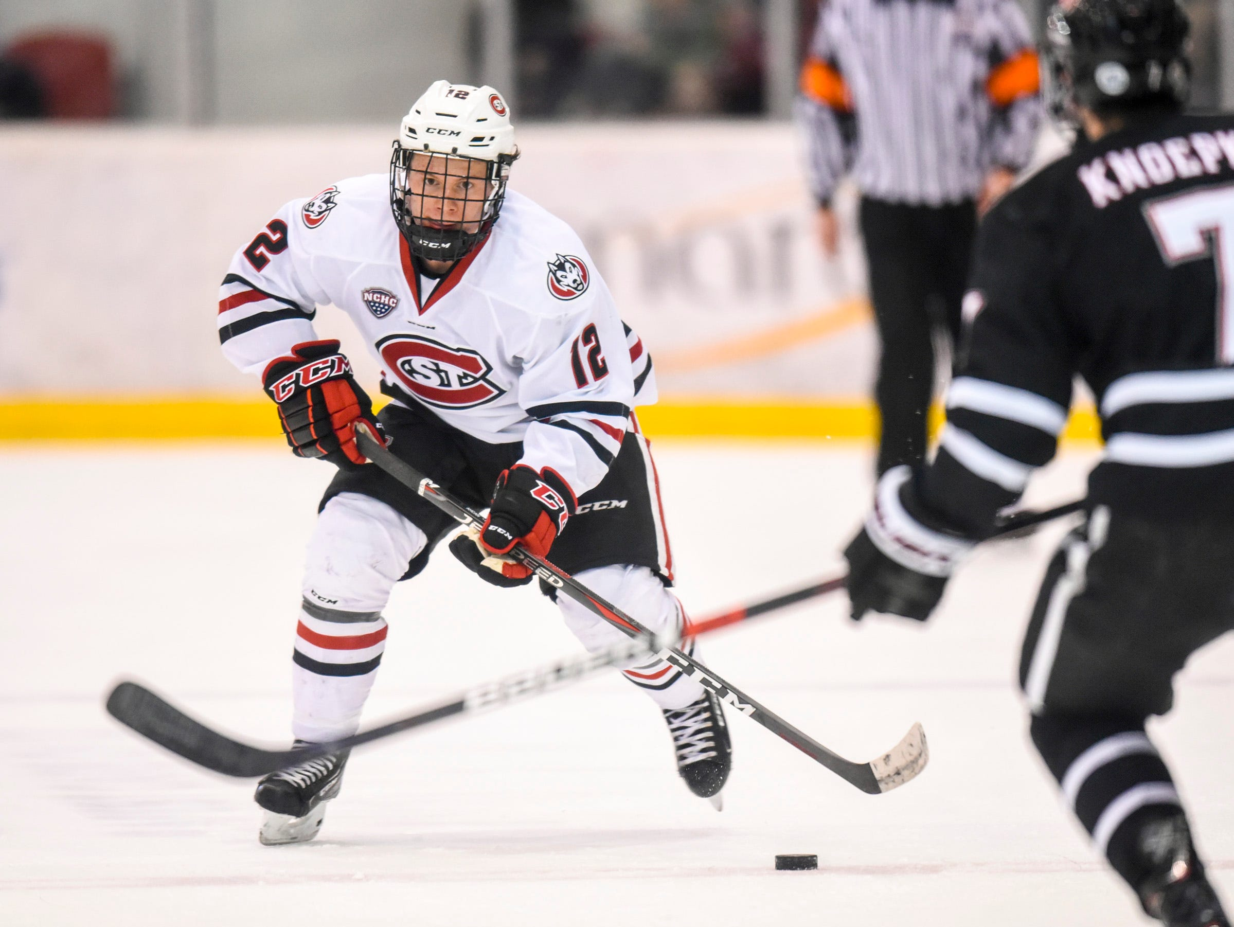 St. Cloud State's Jack Ahcan skates with the puck during the first period Saturday, Dec. 8, at the Herb Brooks National Hockey Center.