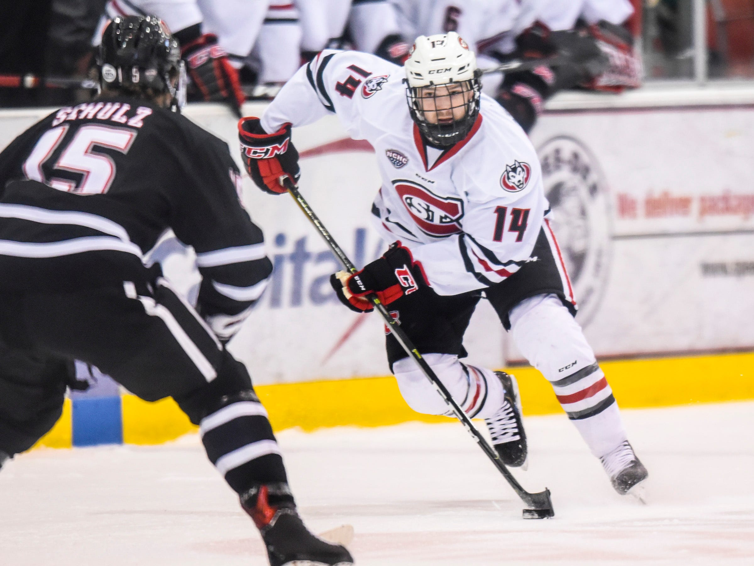 St. Cloud State's Patrick Newell skates with the puck against Nebraska-Omaha during the first period Saturday, Dec. 8, at the Herb Brooks National Hockey Center.