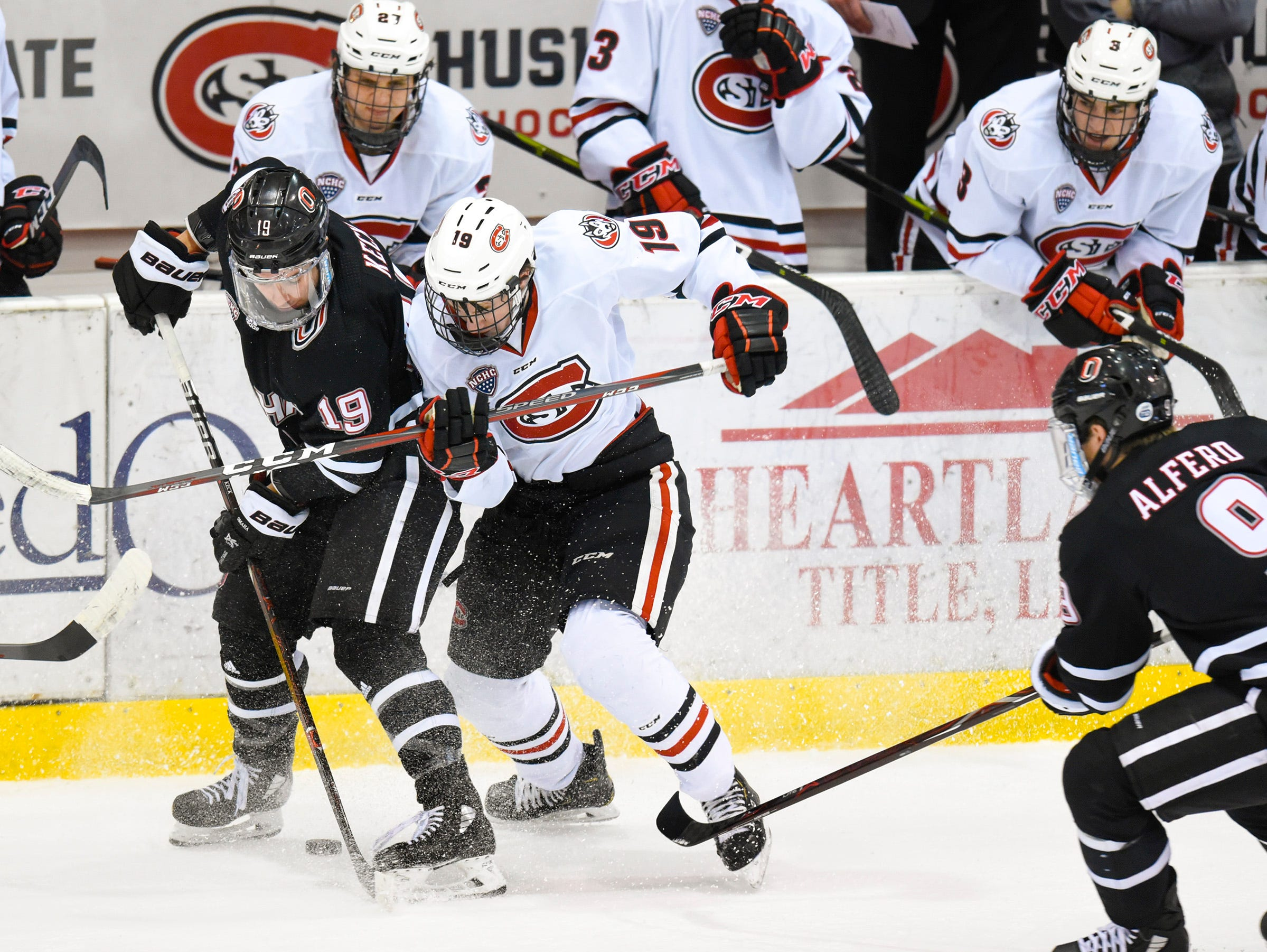 St. Cloud State's Sam Hentges and Nebraska-Omaha's Tristan Keck battle for the puck during the first period Saturday, Dec. 8, at the Herb Brooks National Hockey Center.