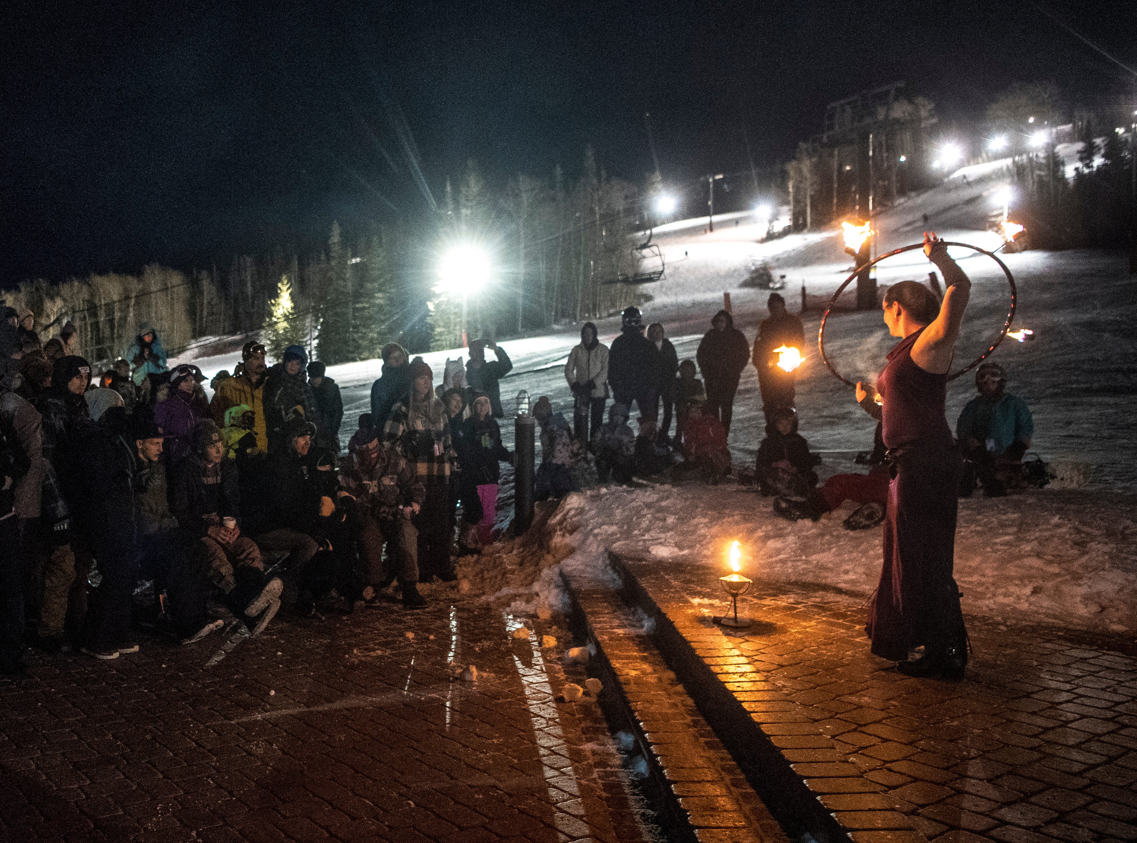 Fire dancers perform at Brian Head Resort during a sacrifice to ULLR, norse god of winter, Saturday, December 8, 2018. The celebration included live music, a drum circle, and fire dancing.