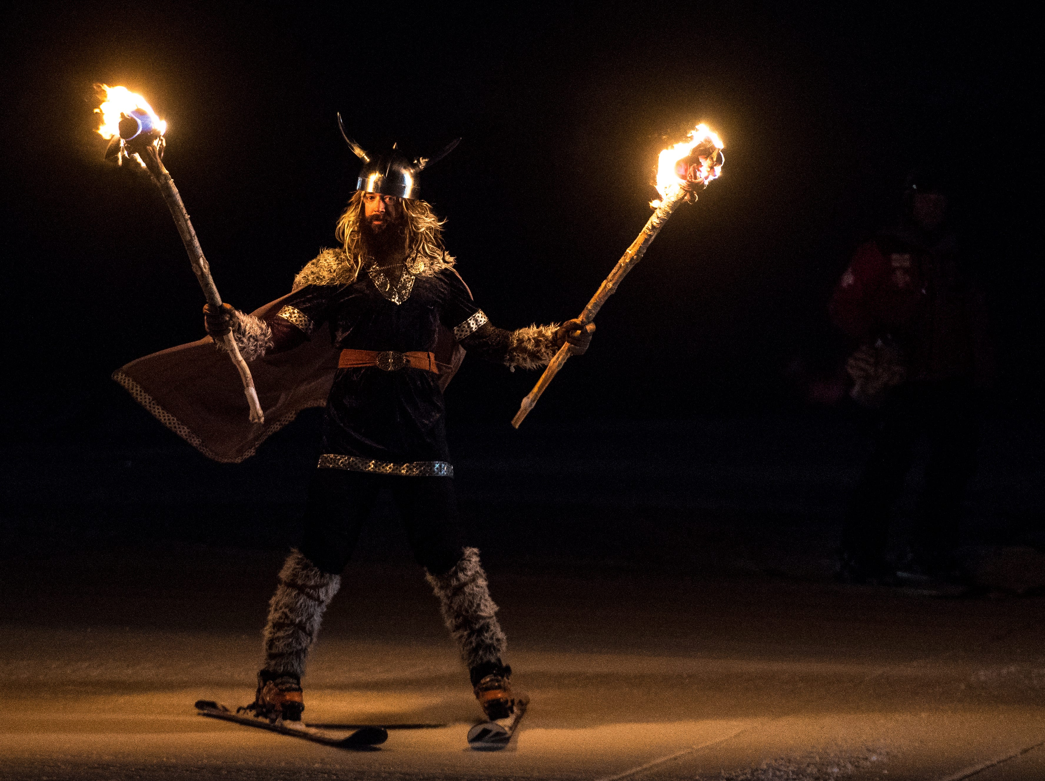 ULLR, the Norse god of snow, arrives for a winter celebration at Brian Head Resort Saturday, December 8, 2018. The celebration included live music, a drum circle, and fire dancing.