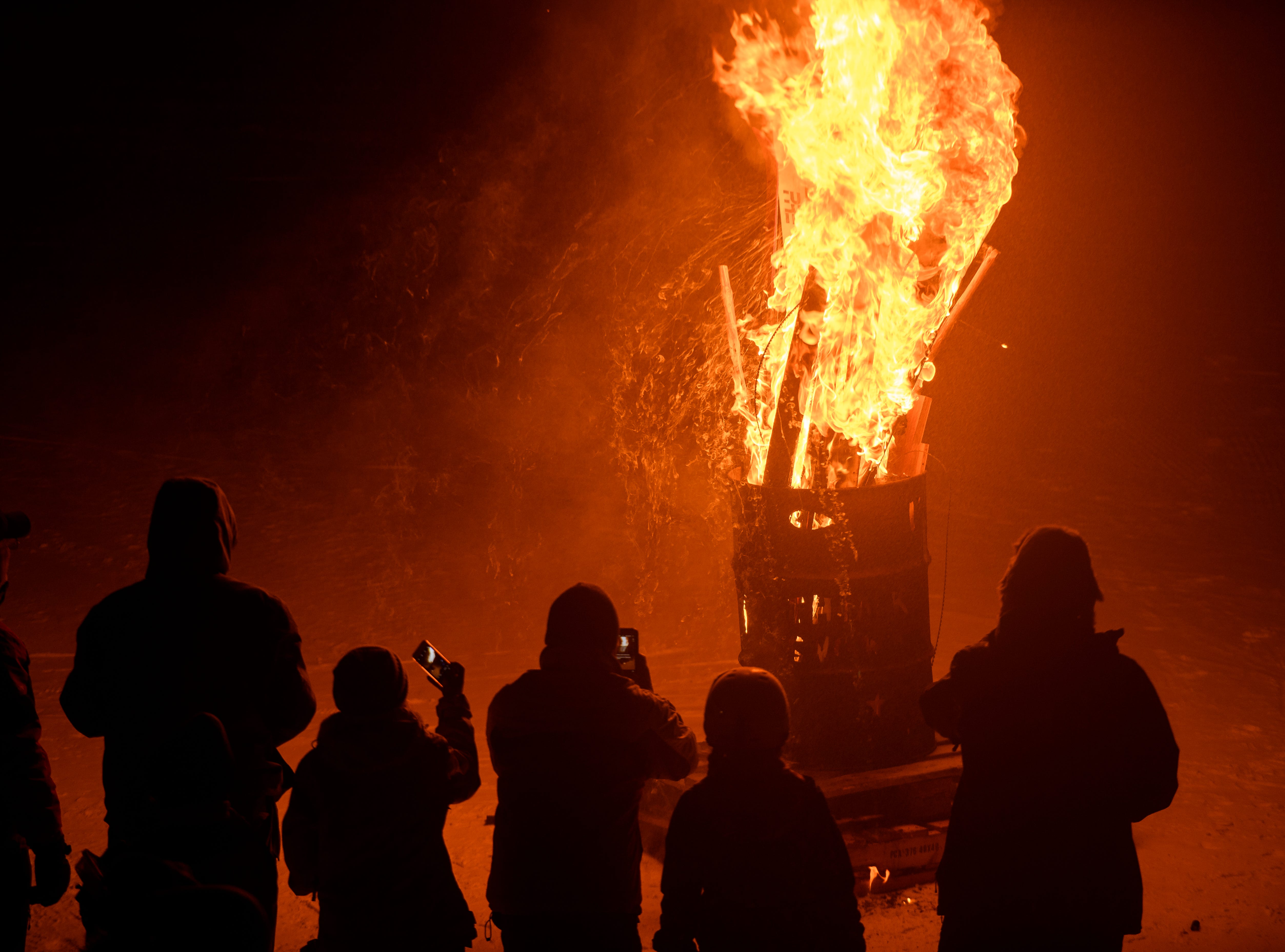 Skiers bring in the winter season by sacrificing skis and snow boards to ULLR, the Norse god of snow at Brian Head Resort Saturday, December 8, 2018. The celebration included live music, a drum circle, and fire dancing.