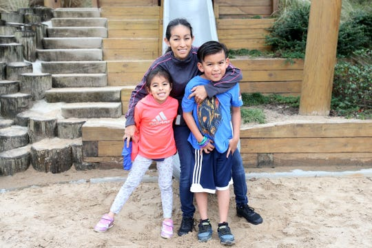"""""""Living in Tallahassee for the past four months, it's a big change because I'm from Mexico and it's a big change for my kids and it's safe is the best part of the year,"""" Yardina Moreno, 36, with daughter Kedesh, 6, left, and son Kaleb, 8, at Cascades Park, Sunday, Dec. 9, 2018."""