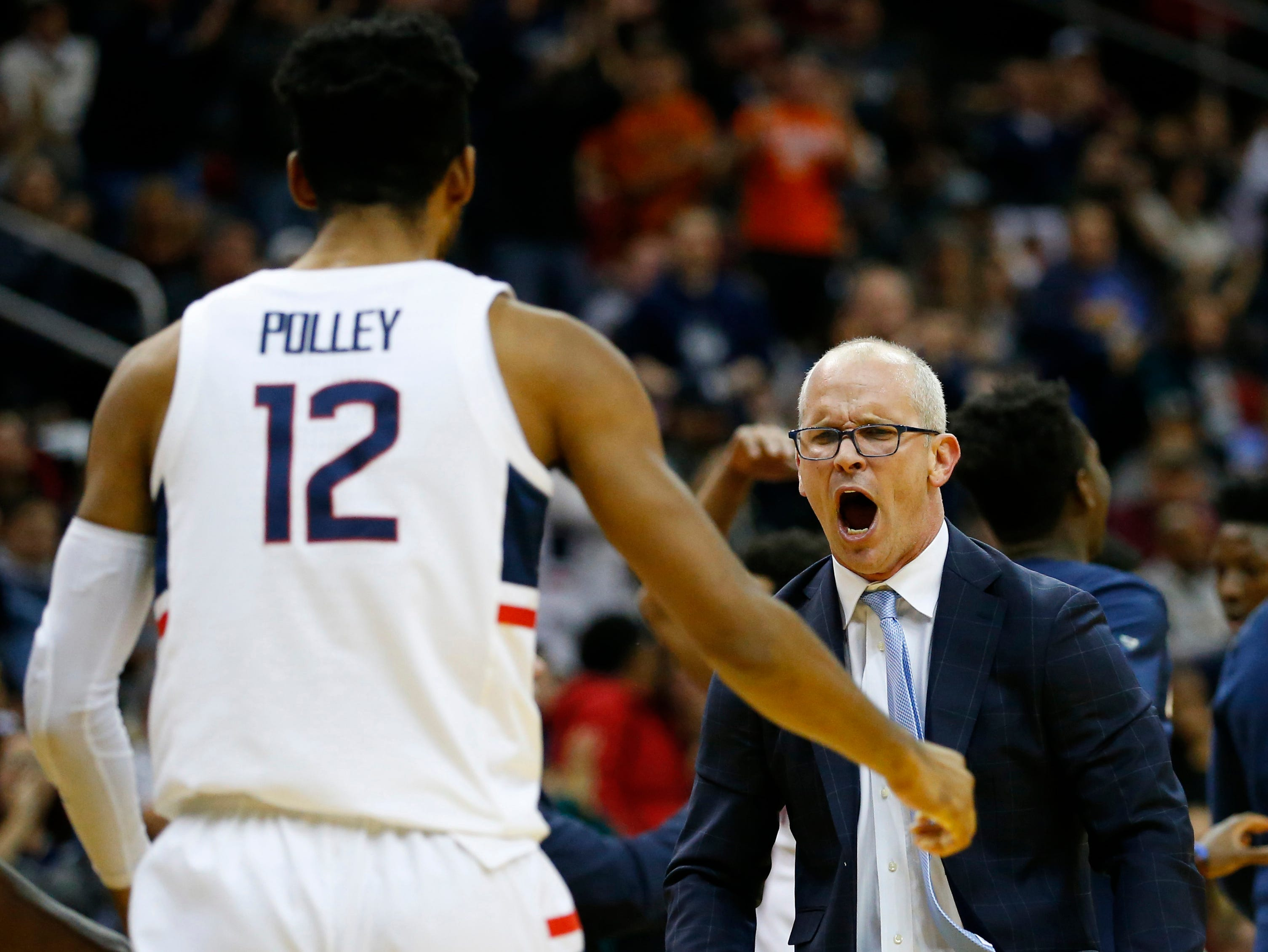 Dec 8, 2018; Newark, NJ, USA; Connecticut Huskies forward Tyler Polley (12) reacts with head coach Dan Hurley after scoring against Florida State Seminoles during the first half at Prudential Center. Mandatory Credit: Noah K. Murray-USA TODAY Sports