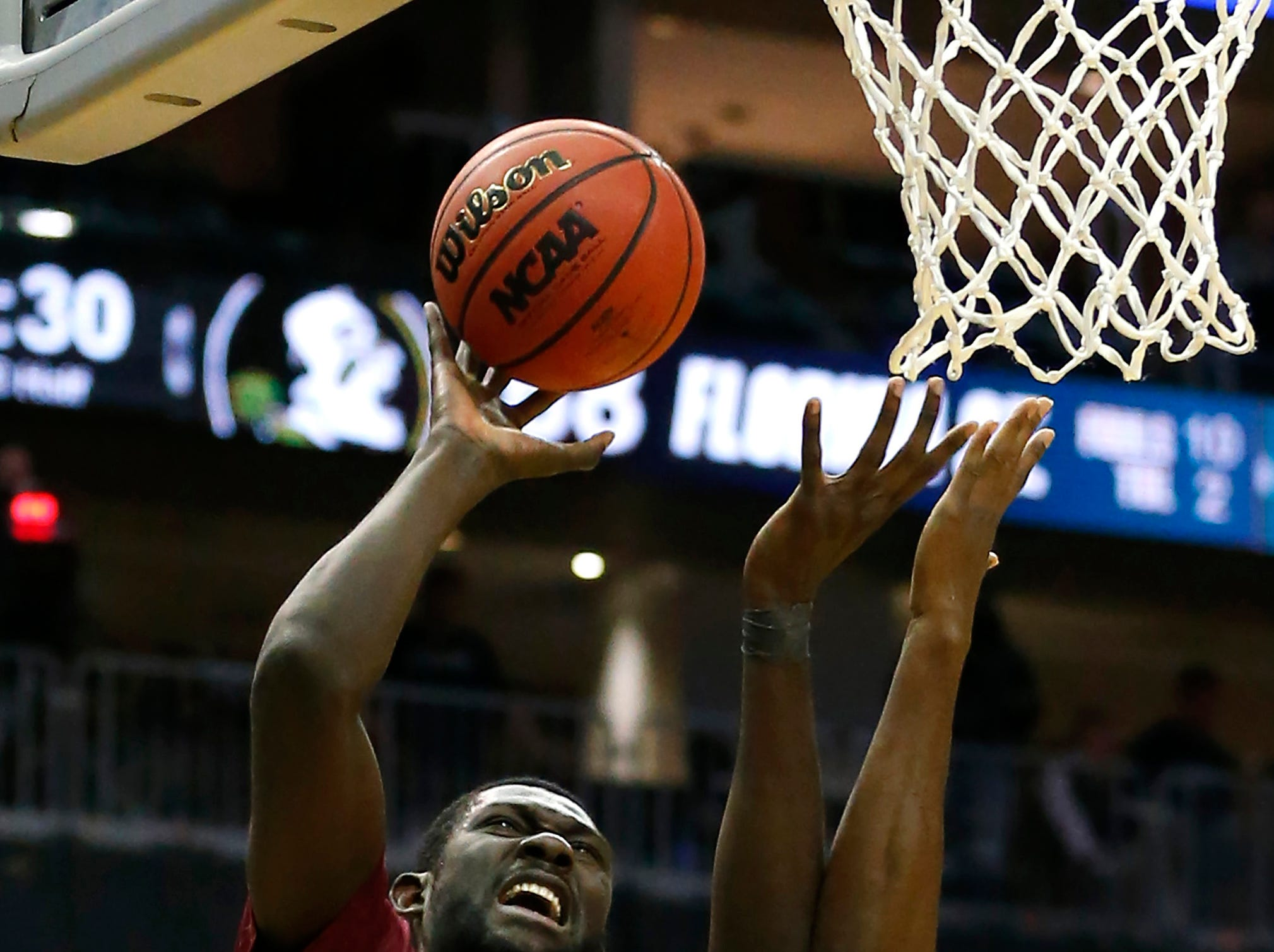 Dec 8, 2018; Newark, NJ, USA; Florida State Seminoles center Christ Koumadje (21) shoots the ball as Connecticut Huskies forward Kassoum Yakwe (14) defends during the second half at Prudential Center. Mandatory Credit: Noah K. Murray-USA TODAY Sports