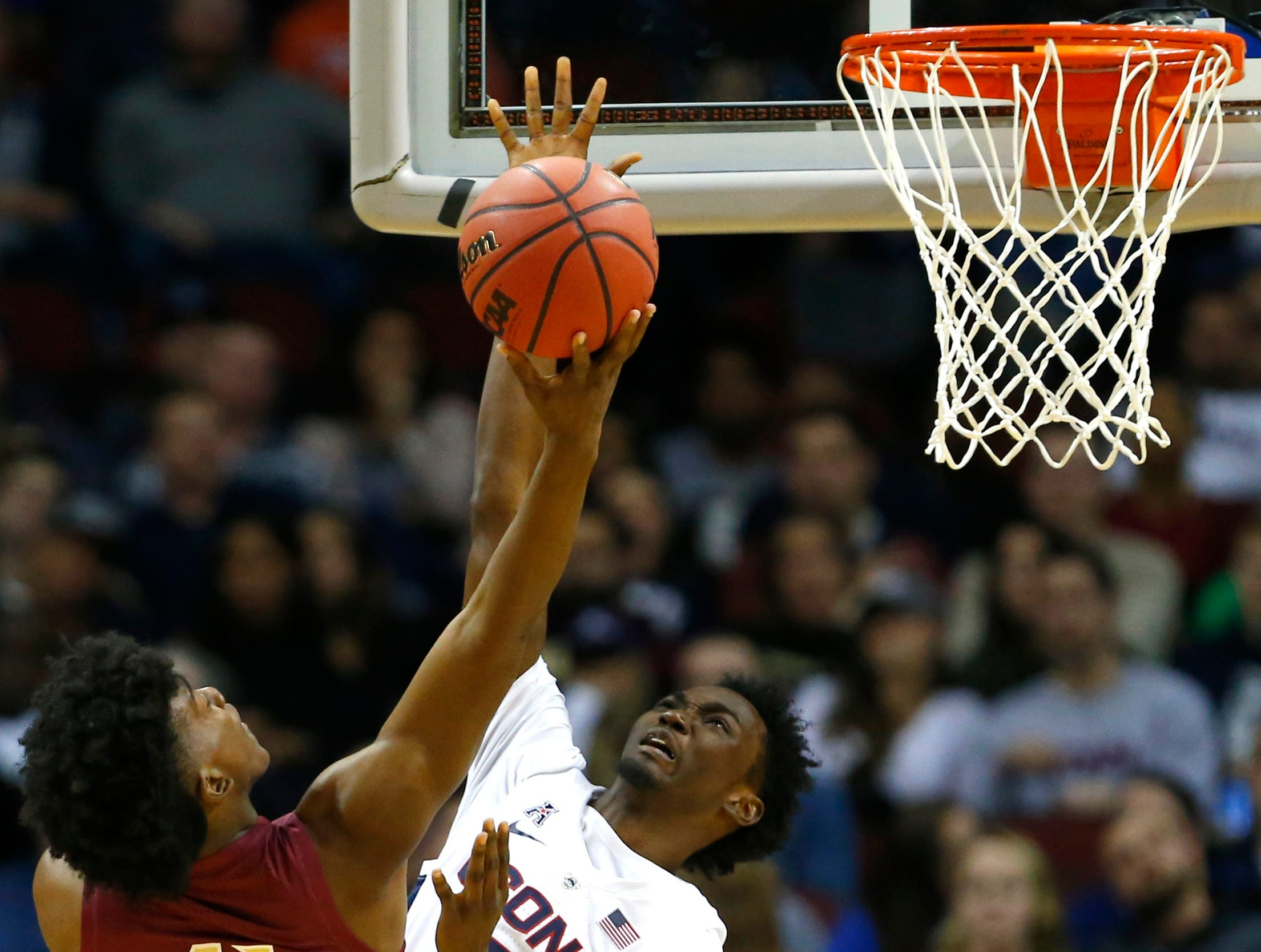 Dec 8, 2018; Newark, NJ, USA; Connecticut Huskies guard Sidney Wilson (15) defends against  Florida State Seminoles guard Terance Mann (41) during                                                                                                                                                                               the second half at Prudential Center. Mandatory Credit: Noah K. Murray-USA TODAY Sports