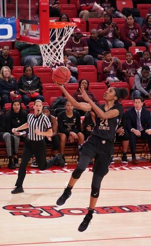 FSU freshman guard Morgan Jones makes a layup against St. Johns.