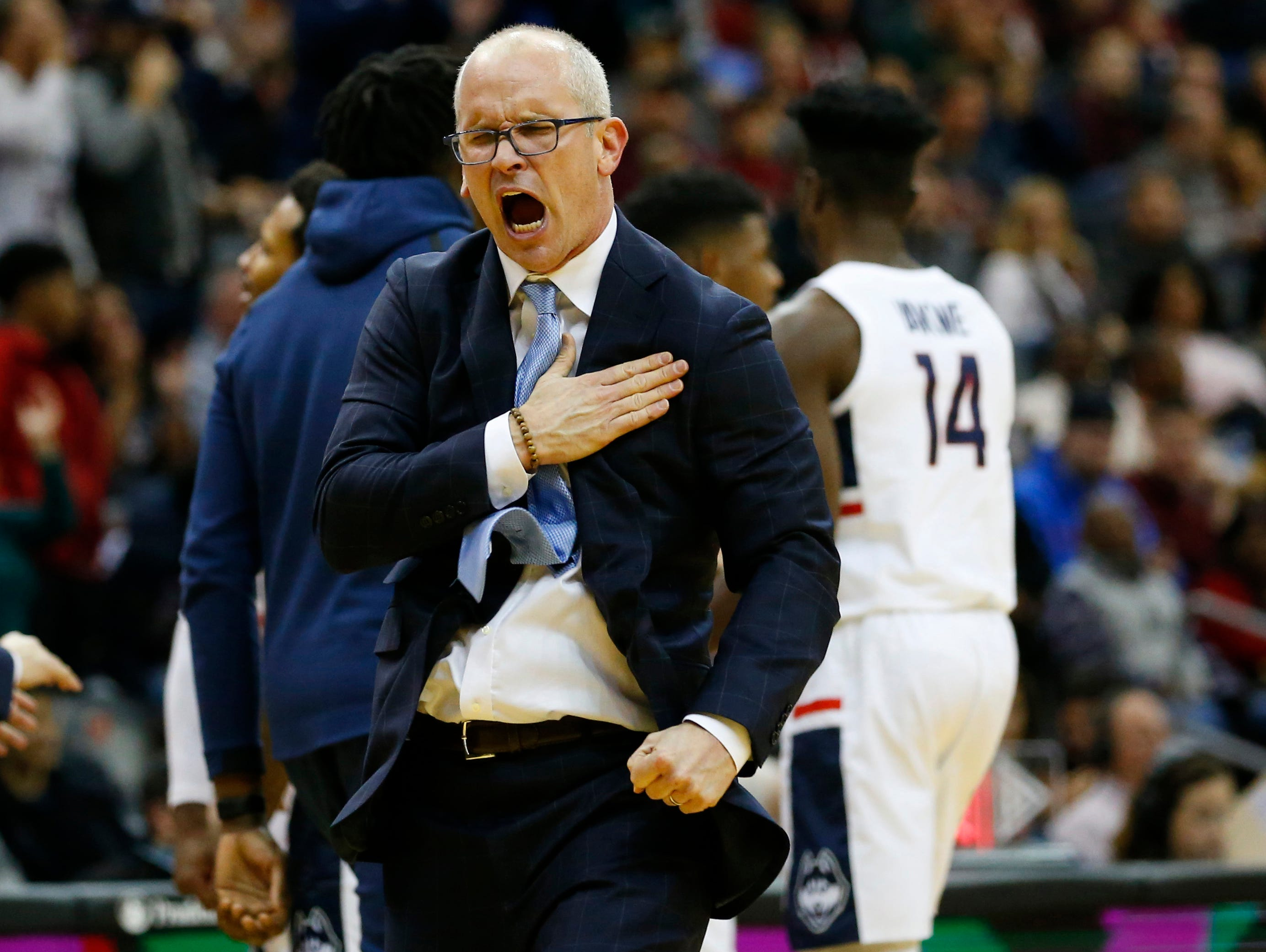 Dec 8, 2018; Newark, NJ, USA; Connecticut Huskies head coach Dan Hurley reacts after the Huskies scored against the Florida State Seminoles during the first half at Prudential Center. Mandatory Credit: Noah K. Murray-USA TODAY Sports