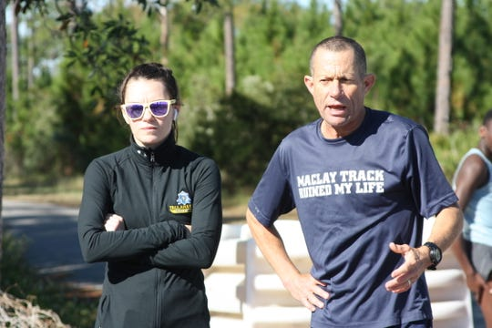 TCC cross country coach Gary Droze observes practice with his assistant, Samantha Reilly. Both coaches will oversee the school's newly-installed track team.