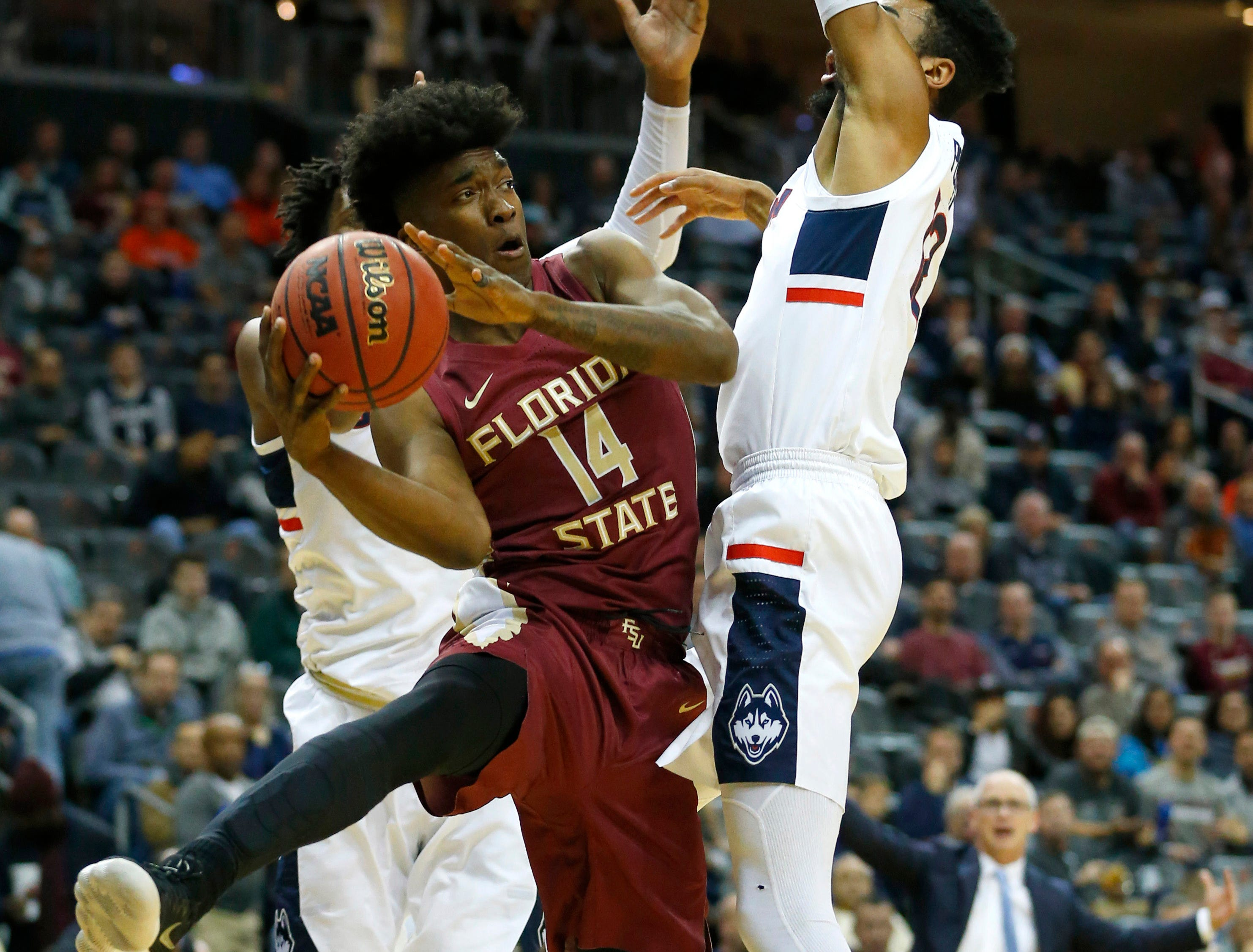 Dec 8, 2018; Newark, NJ, USA; Florida State Seminoles guard Terance Mann (14) shoots the ball around Connecticut Huskies forward Tyler Polley (12) during the first half at Prudential Center. Mandatory Credit: Noah K. Murray-USA TODAY Sports