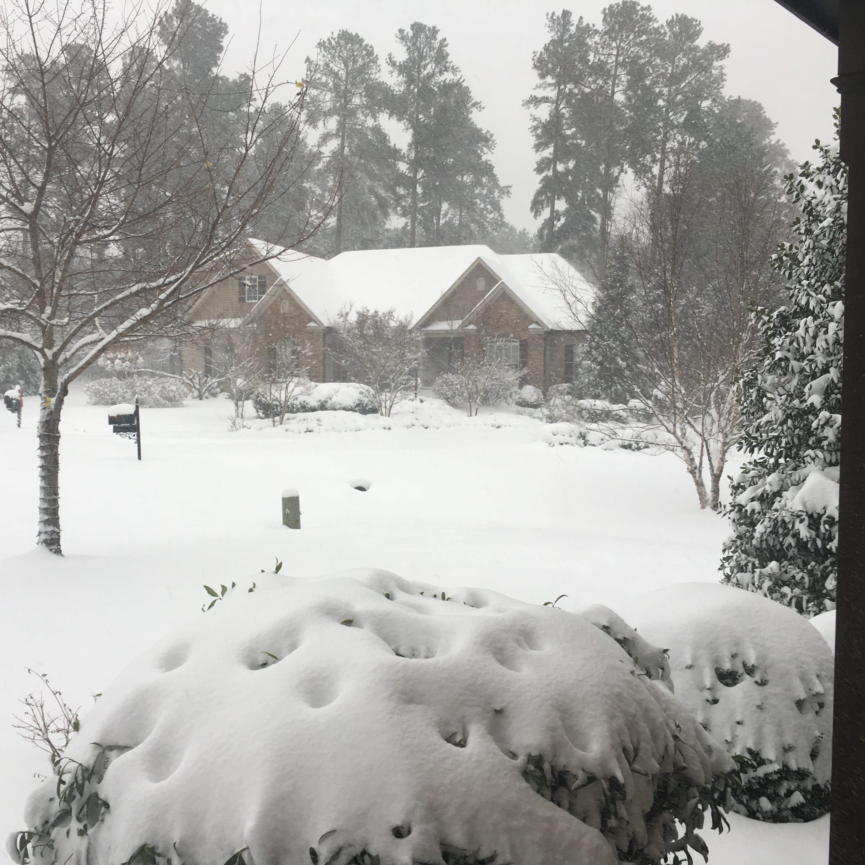 Former Seminole baseball player Link Jarrett busy shoveling snow Sunday
