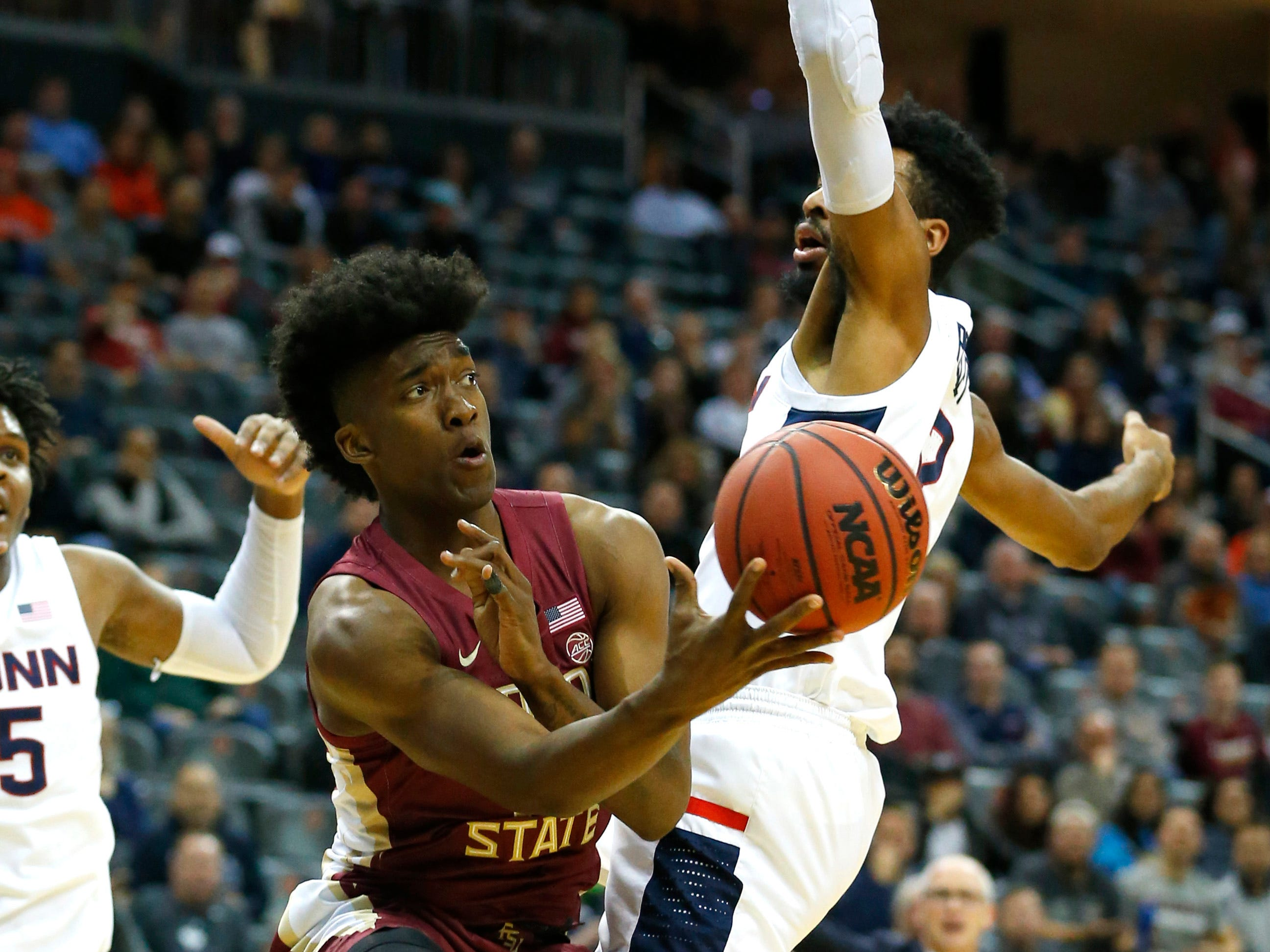 Mann, bench lift 'Noles to victory over UConn, 79-71
