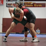 Florida High's Chauncy Riggsby and Lincoln's Andrew Collins wrestle Saturday during the Cam Brown Seminole Classic wrestling tournament at Florida High.