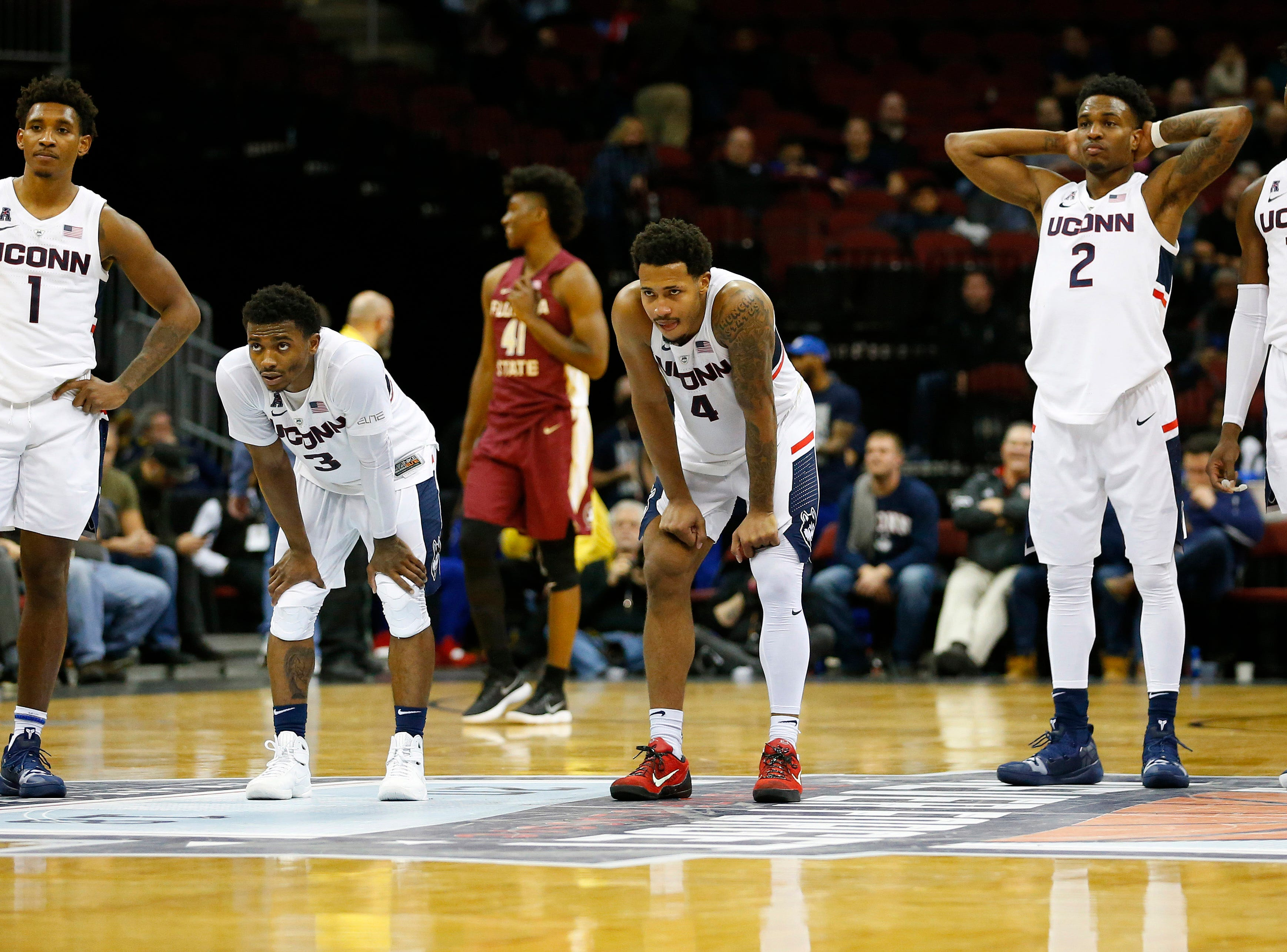 Dec 8, 2018; Newark, NJ, USA; Connecticut Huskies players watch from the court as the Florida State Seminoles shoot a technical foul during the second half at Prudential Center. Mandatory Credit: Noah K. Murray-USA TODAY Sports