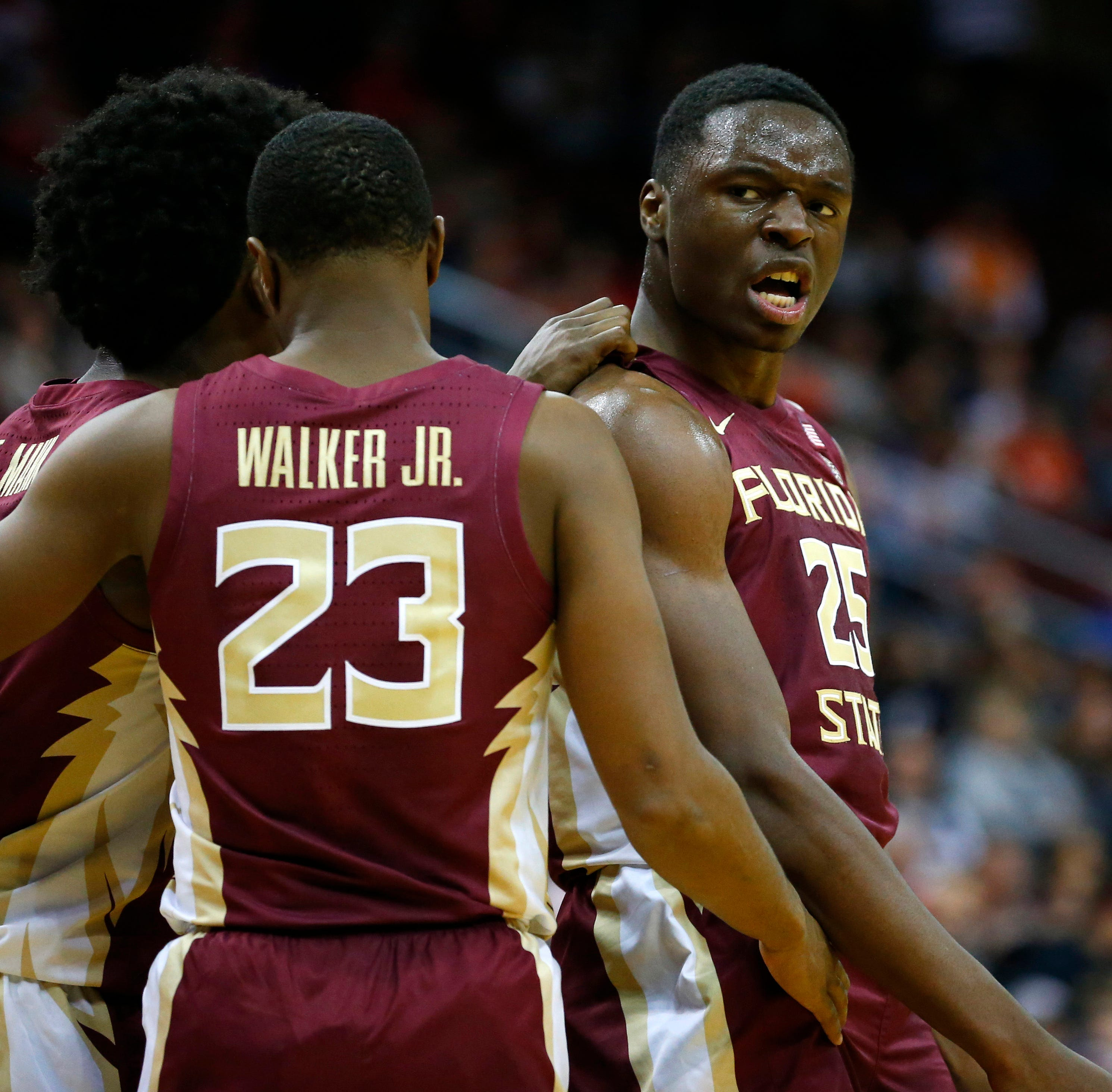 Mann scores 20 as No. 11 Florida State beats UConn 79-71