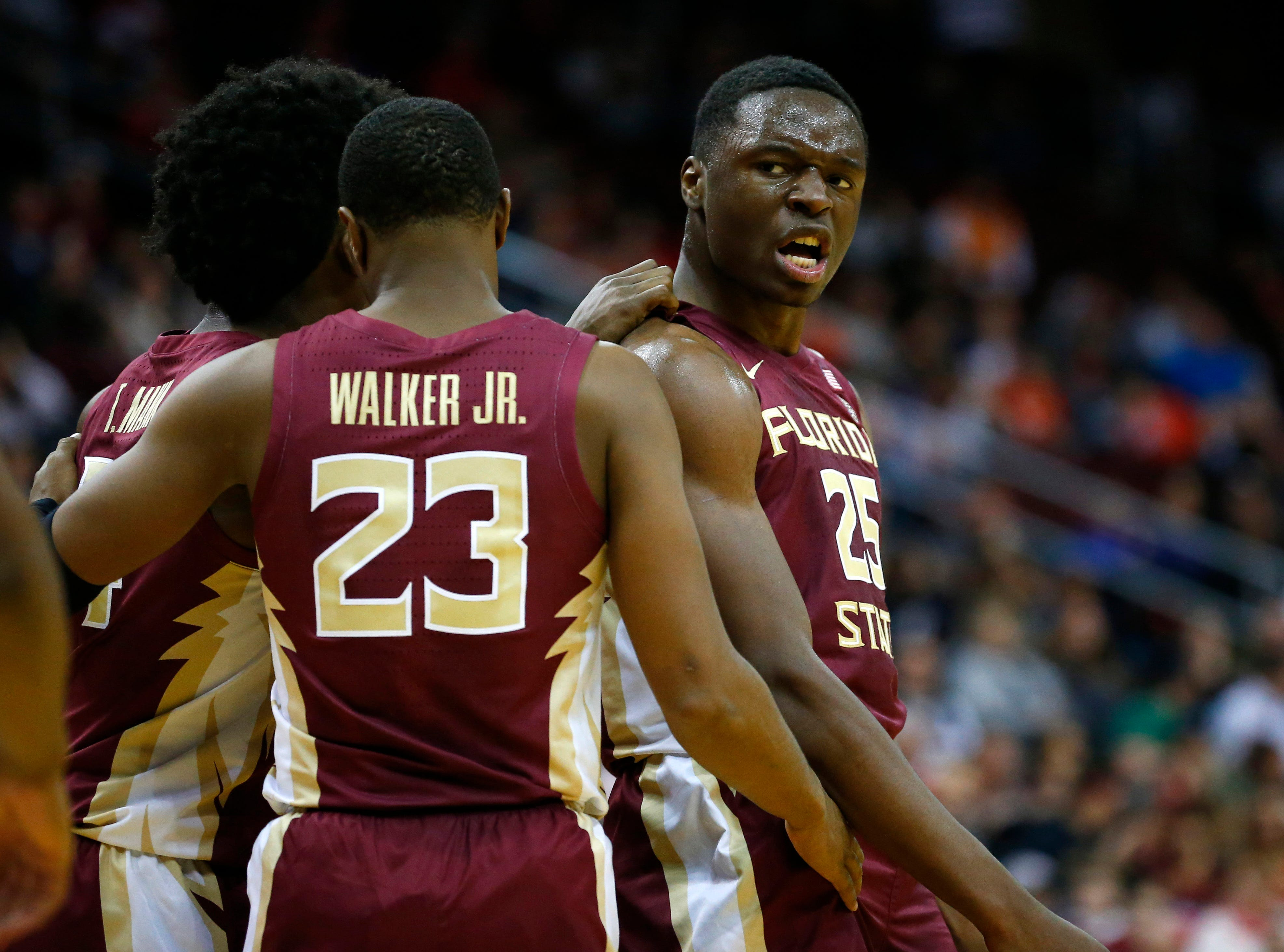 Dec 8, 2018; Newark, NJ, USA; Florida State Seminoles forward Mfiondu Kabengele (25) reacts after scoring against the Connecticut Huskies during the first half at Prudential Center. Mandatory Credit: Noah K. Murray-USA TODAY Sports