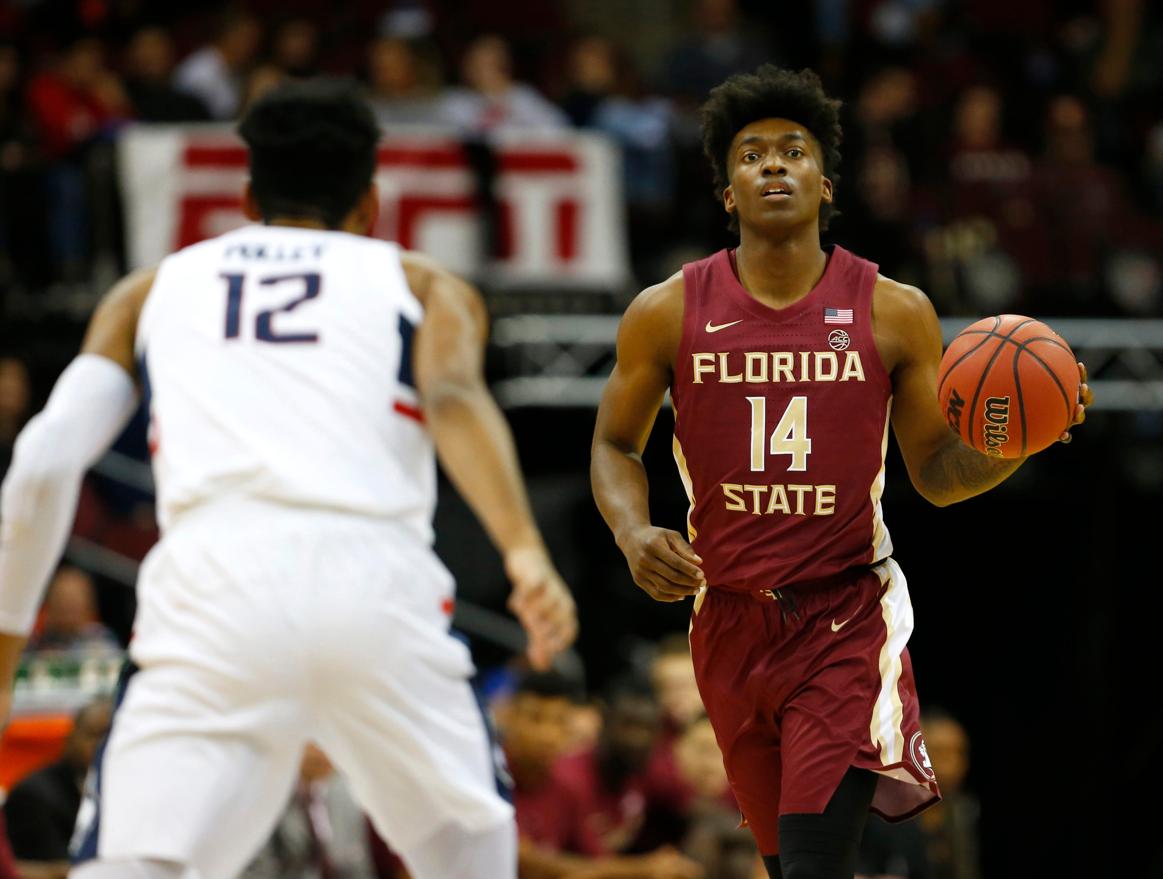 Dec 8, 2018; Newark, NJ, USA; Florida State Seminoles guard Terance Mann (14) handles the ball against Connecticut Huskies forward Tyler Polley (12) during the first half at Prudential Center. Mandatory Credit: Noah K. Murray-USA TODAY Sports